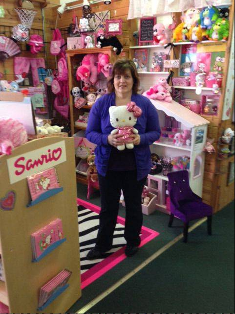 Josie Pucci now runs two stores at the State Street Market Shops in Elgin, but will soon be opening a gift shop in her native West Dundee. The gift shop, slated to open May 1, will sell items for women, and children, like the Hello Kitty animals seen here.