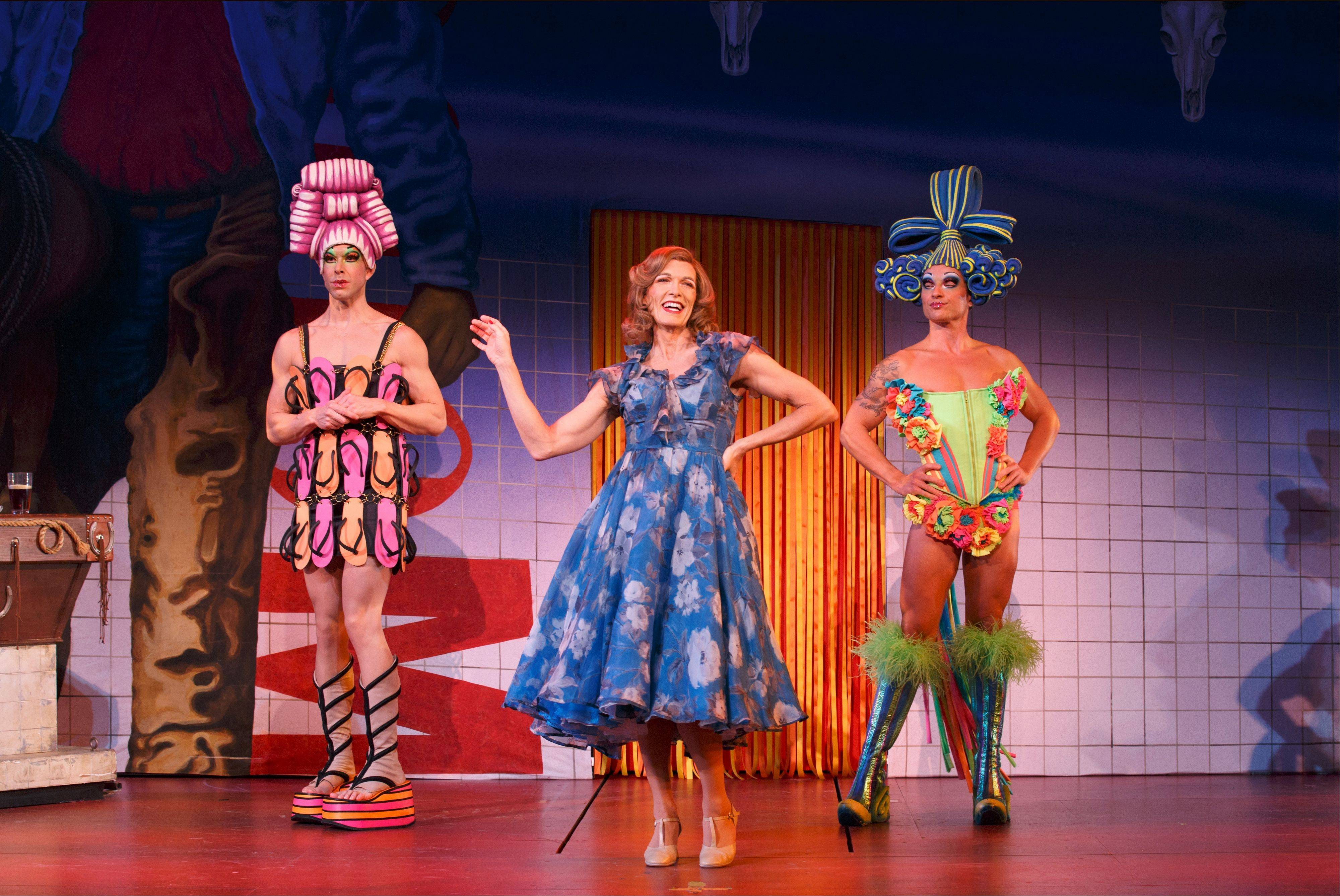 "Wade McCollum, left, Scott Willis and Bryan West star as drag performers on a road trip through the Australian outback in the national tour of ""Priscilla Queen of the Desert -- The Musical."" It's at the Auditorium Theatre for a brief run."