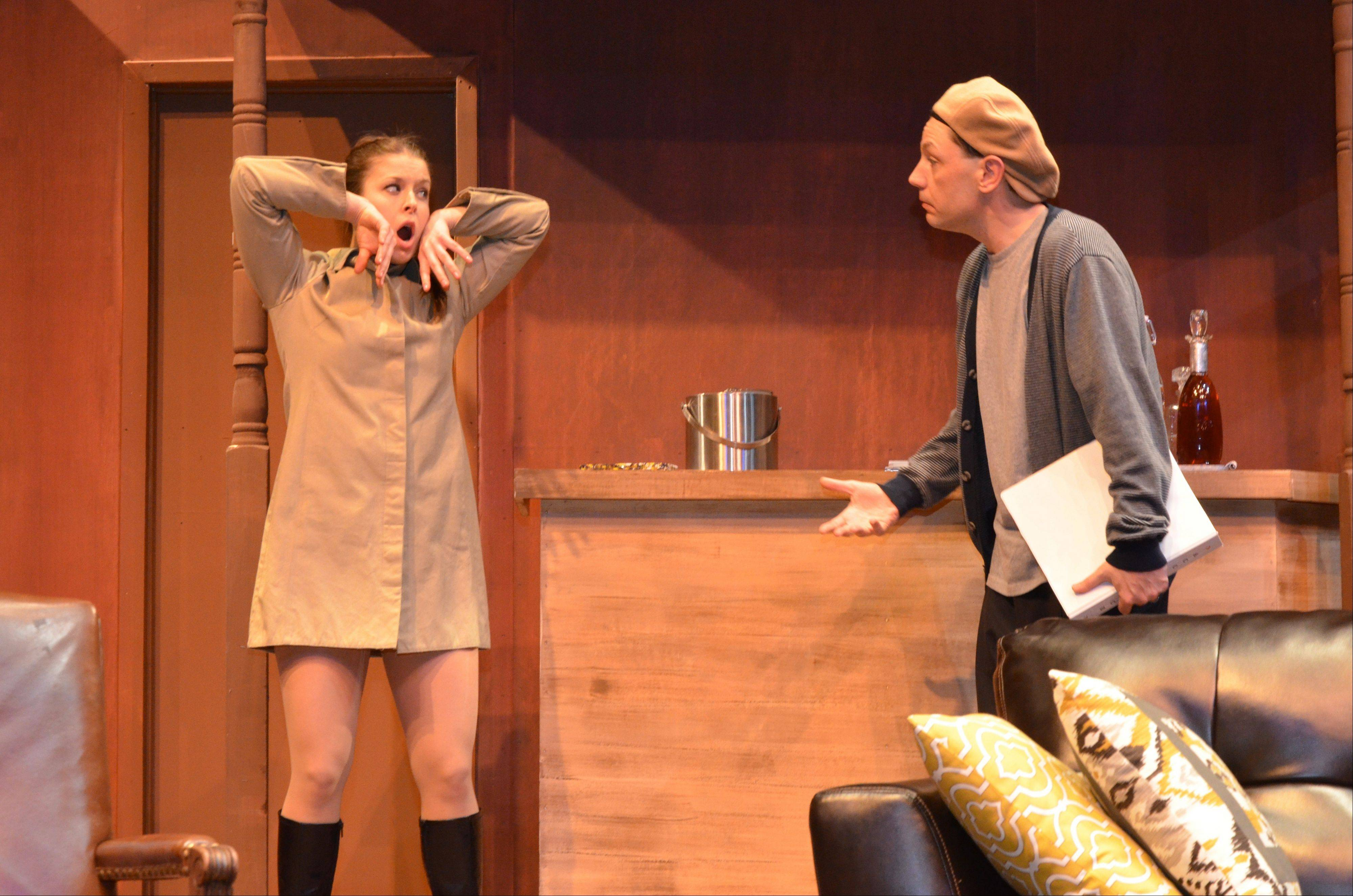 "A young actress (Julie Schroll) gets advice from her director (Jonathan Nichols) in Rupert Holmes' ""Accomplice"" at Arlington Heights' Metropolis Performing Arts Centre."