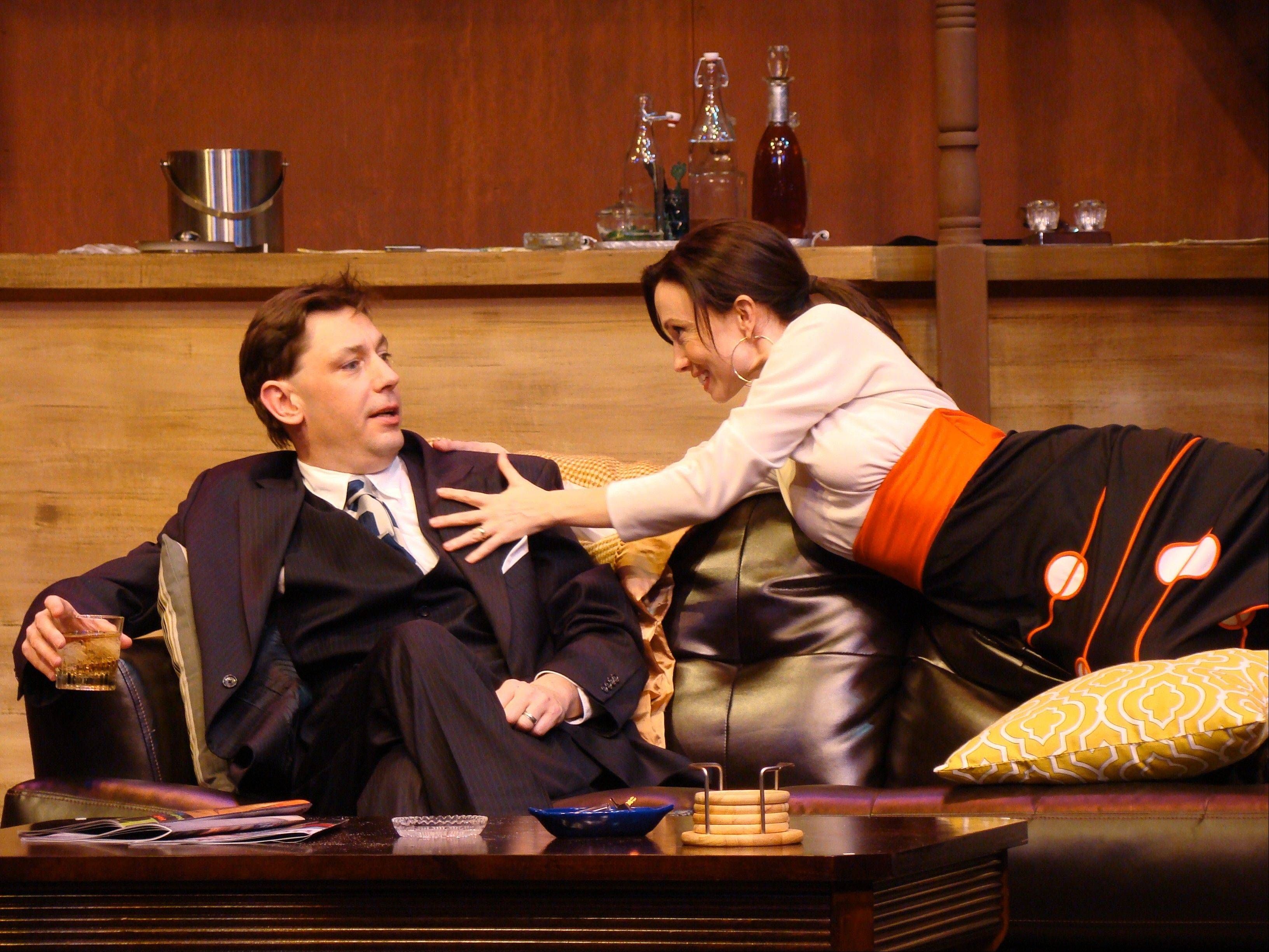 "Janet (Kelly Lynn Hogan) has less than amorous plans for her husband Derek (Jonathan Nichols) in director Robin M. Hughes' production of the comic thriller ""Accomplice,"" running through April 26 at the Metropolis Performing Arts Centre in Arlington Heights."