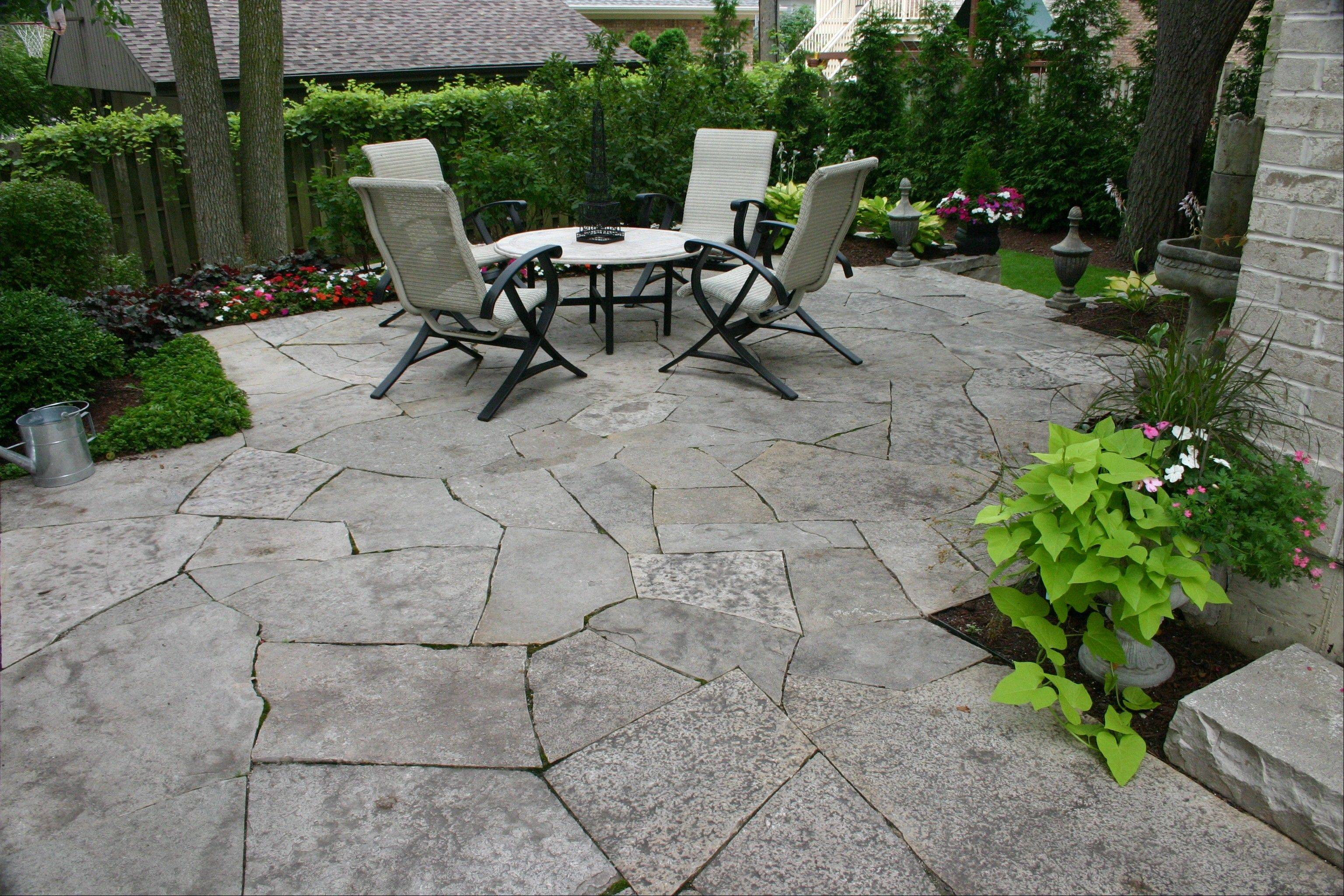 Decorative stone is an option to the standard poured concrete patio or wooded deck buyers consider for their new homes.