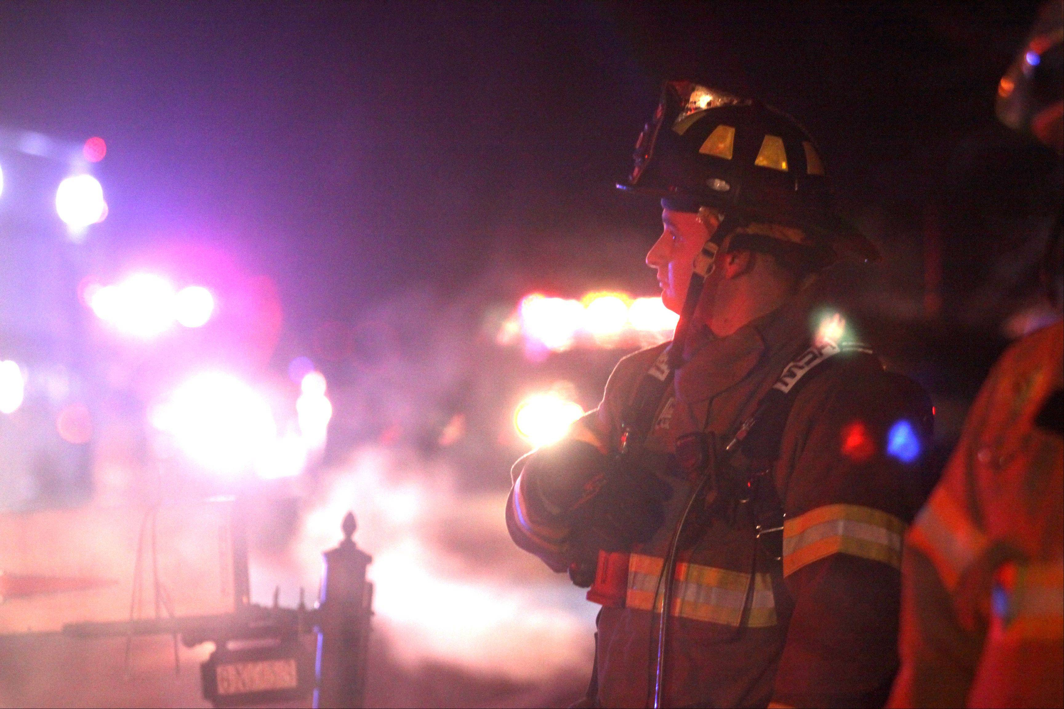 Fire personnel work at the scene fire along Weber Drive in the Valley View subdivision on Friday night.
