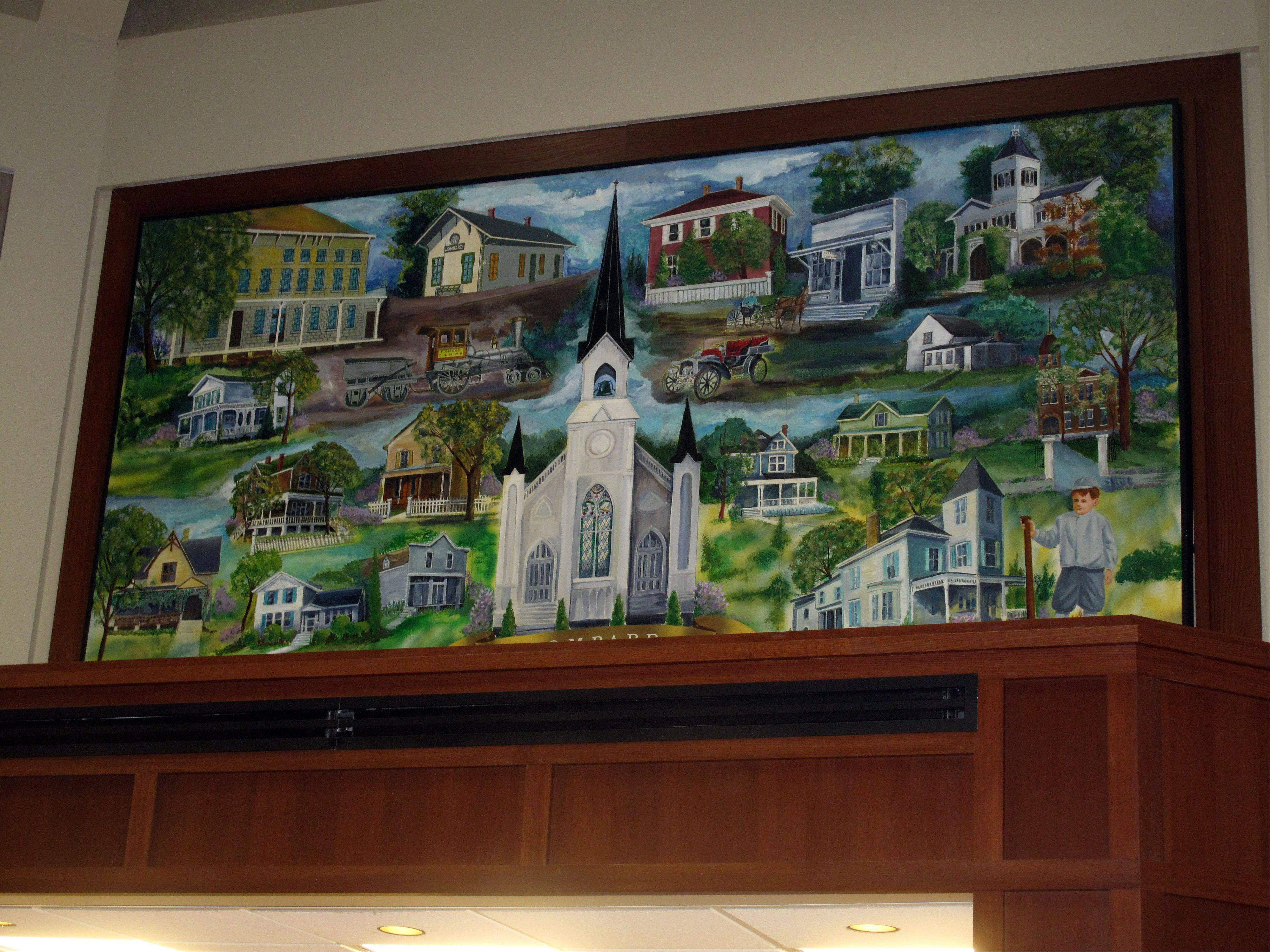 This painting depicting historic buildings in Lombard is hanging above the front counter at village hall once again, after Trustee Laura Fitzpatrick worked to finish it while the counter was undergoing renovations.