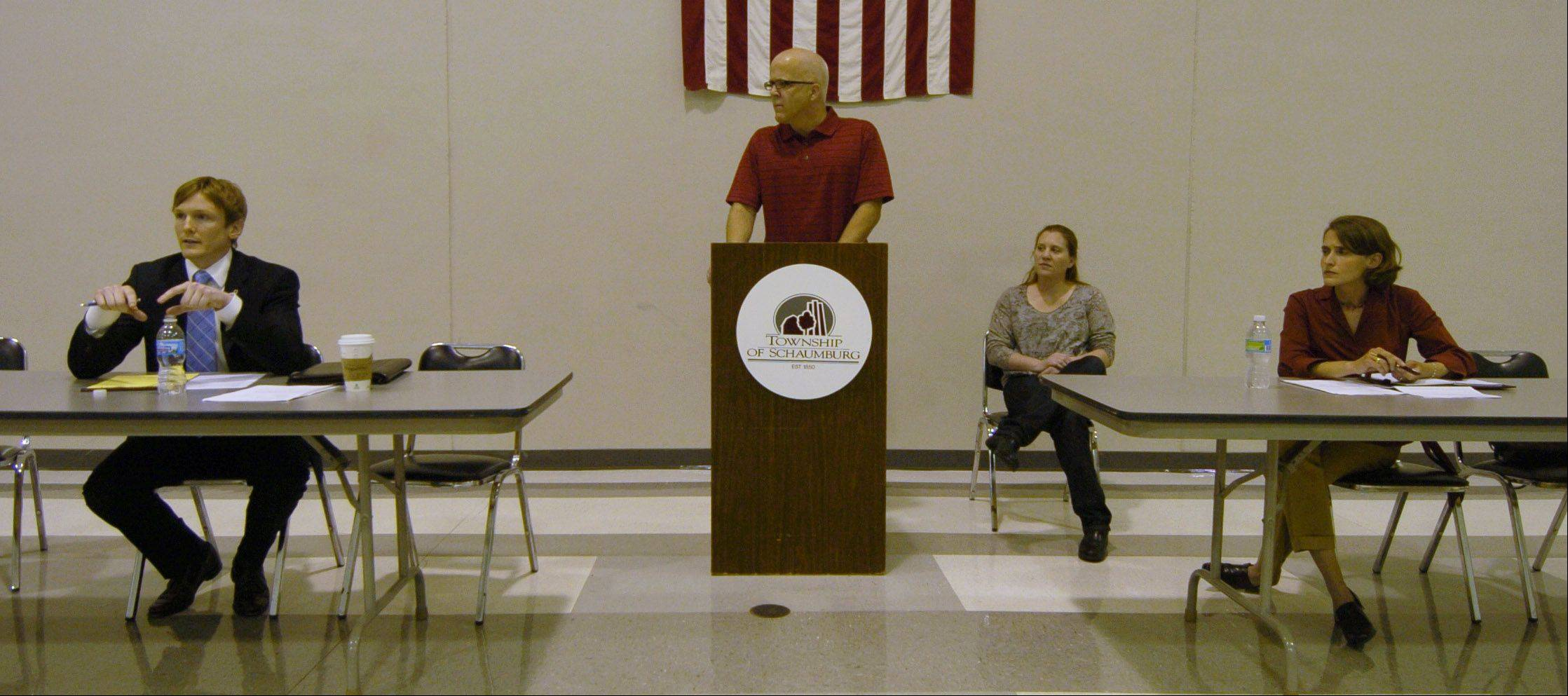 Mike Baker, behind the podium, organized this forum in 2010 for legislative candidates Ryan Higgins, left, and Michelle Mussman, far right, to discuss their commitment to state funding for special needs families. In the back is Amy Bolas, of the Autism Society of America.