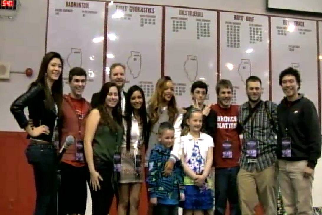 Rihanna, in the middle, posed with the BHS-TV students who made the video that won Barrington High School the pop star's appearance there.