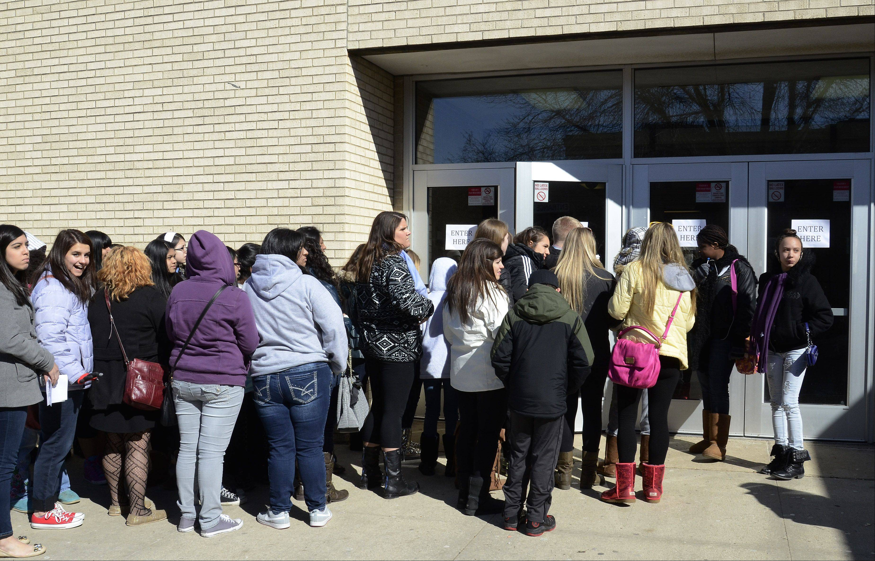 Barrington High School students lined up to see pop star Rihanna make her long-awaited visit to the school.