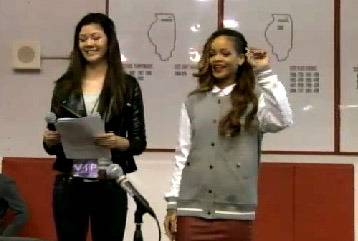 After a more than four-hour delay, Rihanna appears onstage in the gym of Barrington High School after being introduced by Catherine Goetze, BHS-TV's head reporter.