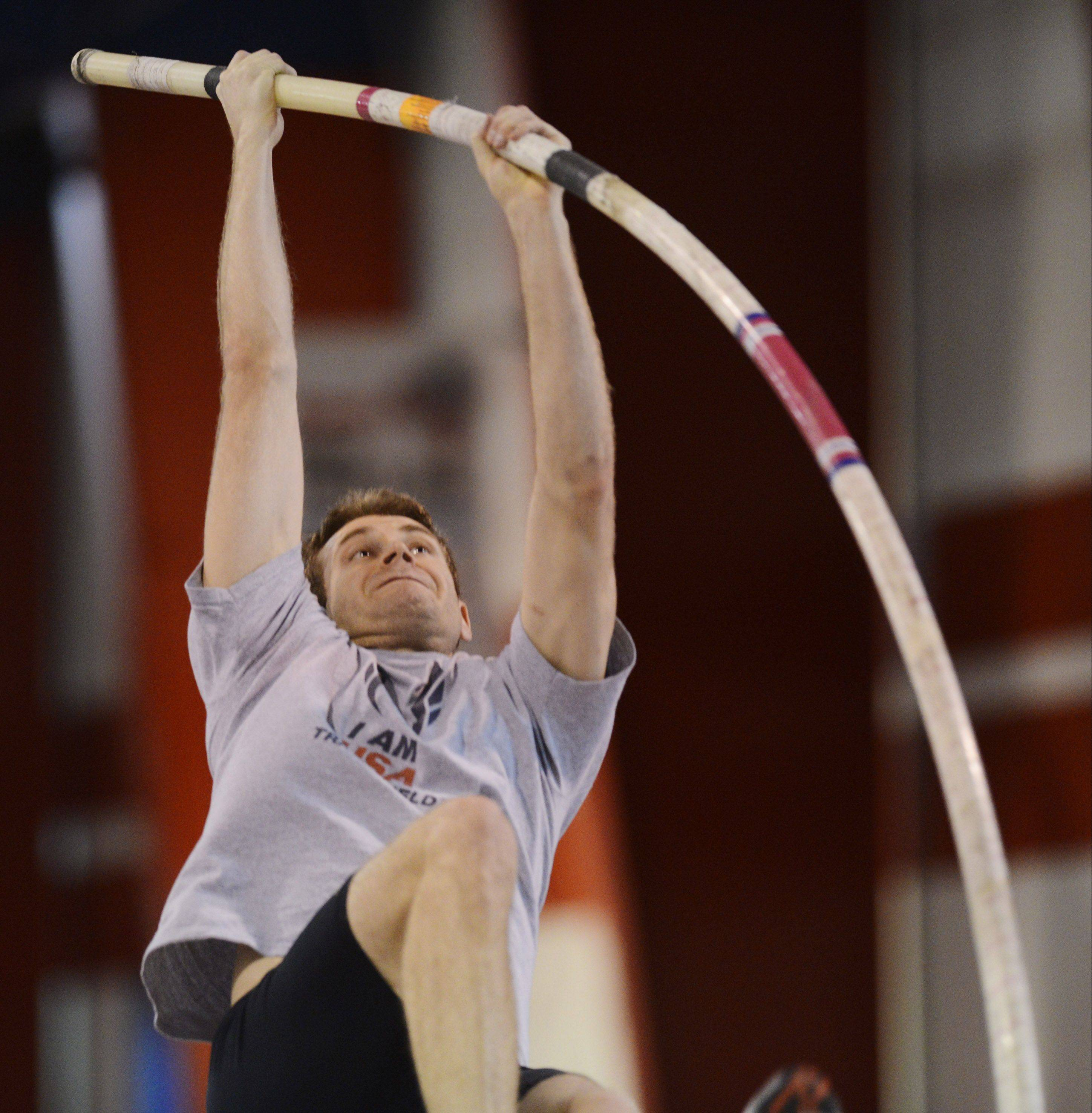 Pole vaulter Darren Niedermeyer makes a jump while working out at the Lewis University Field House.