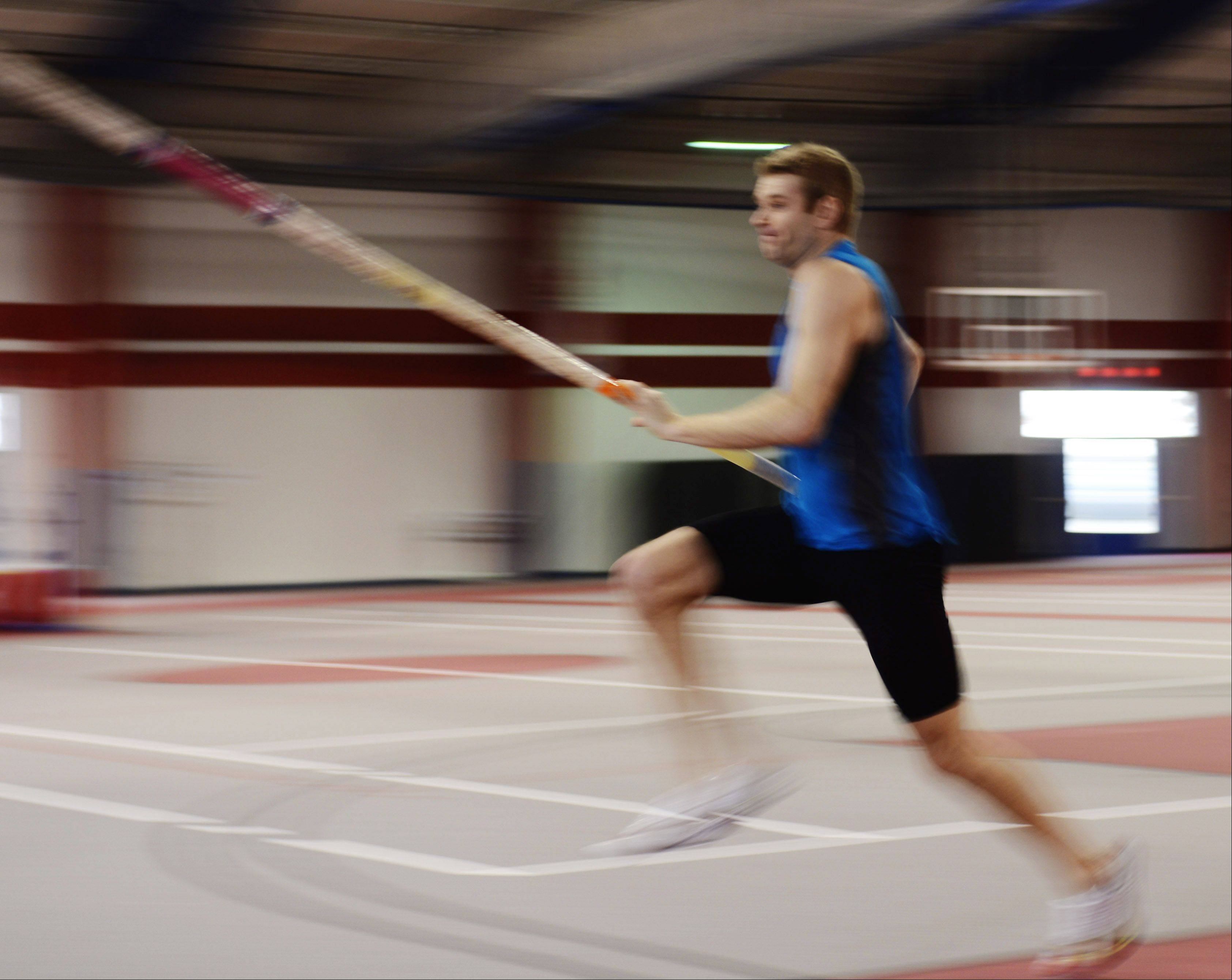 Pole vaulter Darren Niedermeyer gathers speed during practice at the Lewis University Field House.