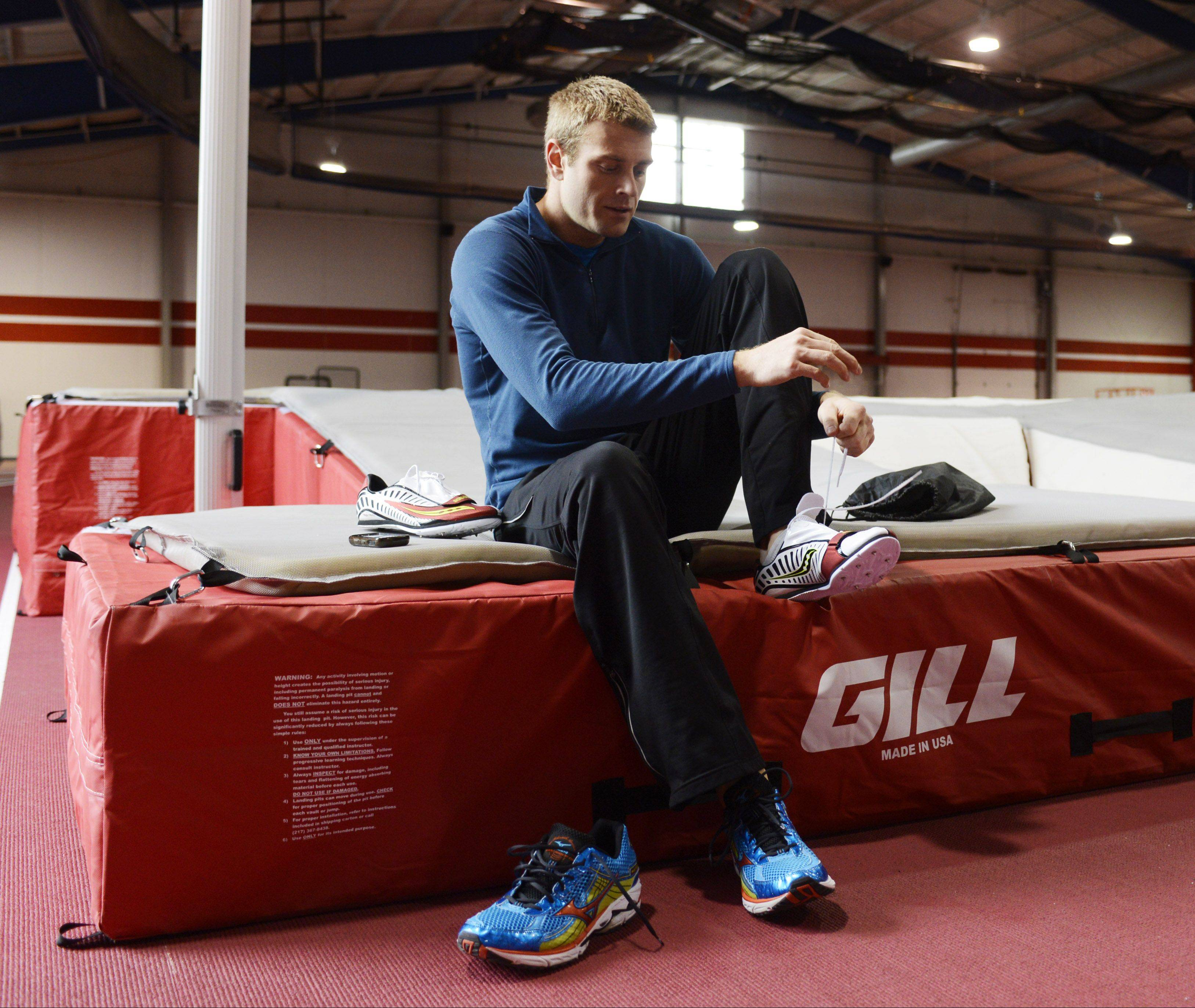 Pole vaulter Darren Niedermeyer laces up his shoes before working out at the Lewis University Field House.