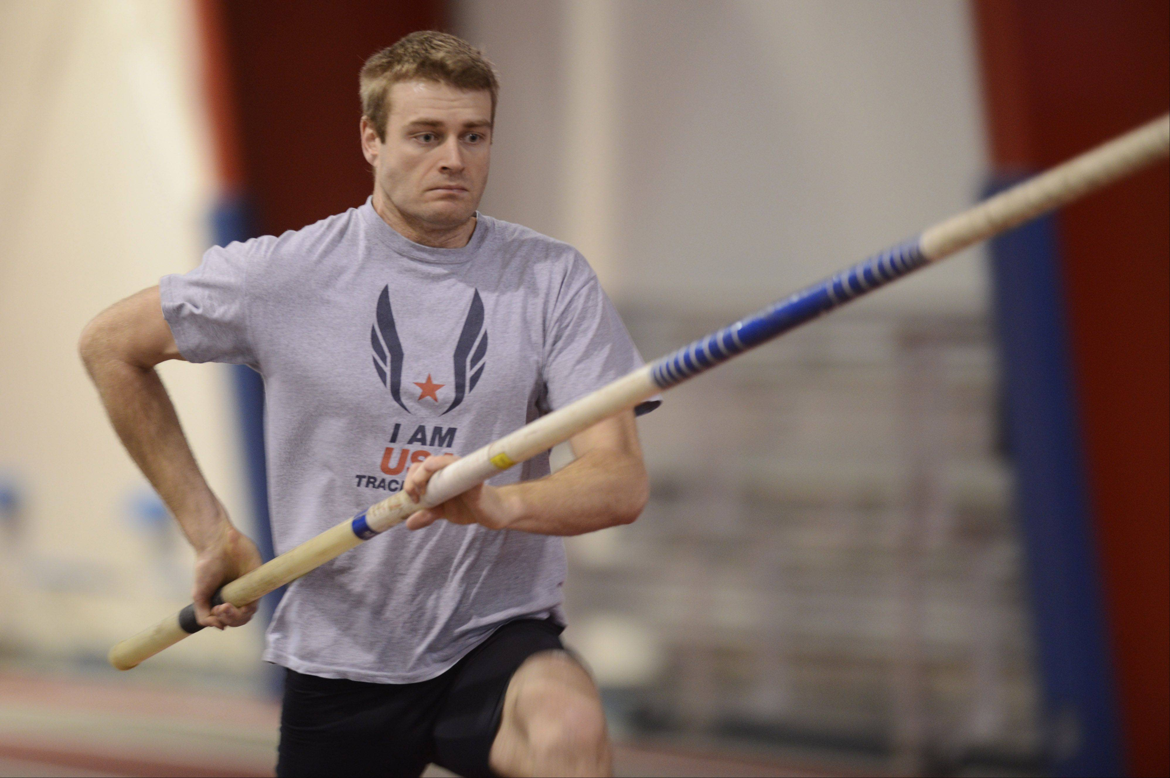 Pole vaulter Darren Niedermeyer works out at the Lewis University Field House.