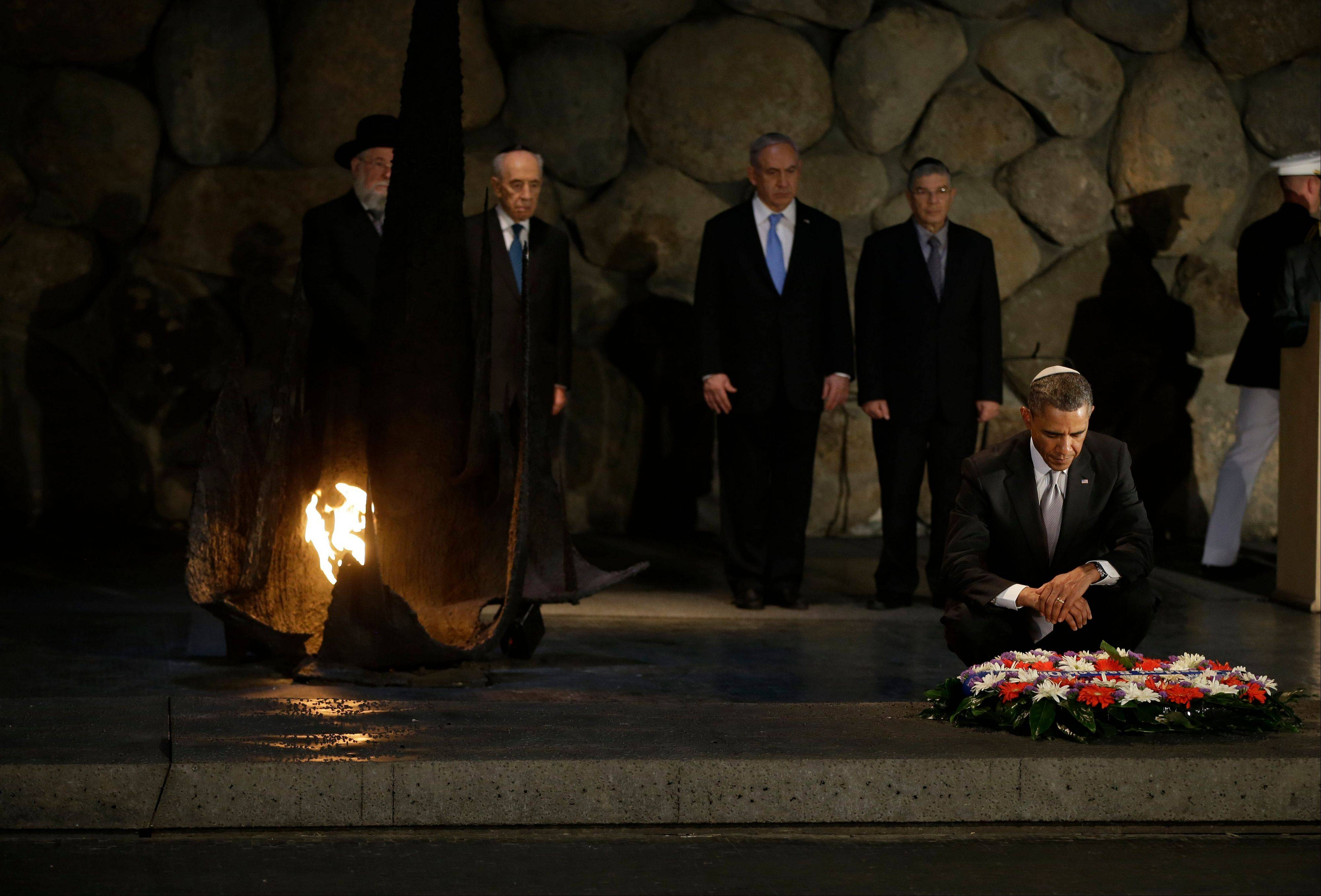 President Barack Obama, right, pauses for after laying a wreath during his visit to the Hall of Remembrance at the Yad Vashem Holocaust Memorial in Jerusalem, Israel, Friday, March 22, 2013. Standing behind Obama are from left to right, Rabbi Israel Meir Lau, left, Israeli President Shimon Peres, Israeli Prime Minister Benjamin Netanyahu, and Chairman of the Memorial Avner Shalev.