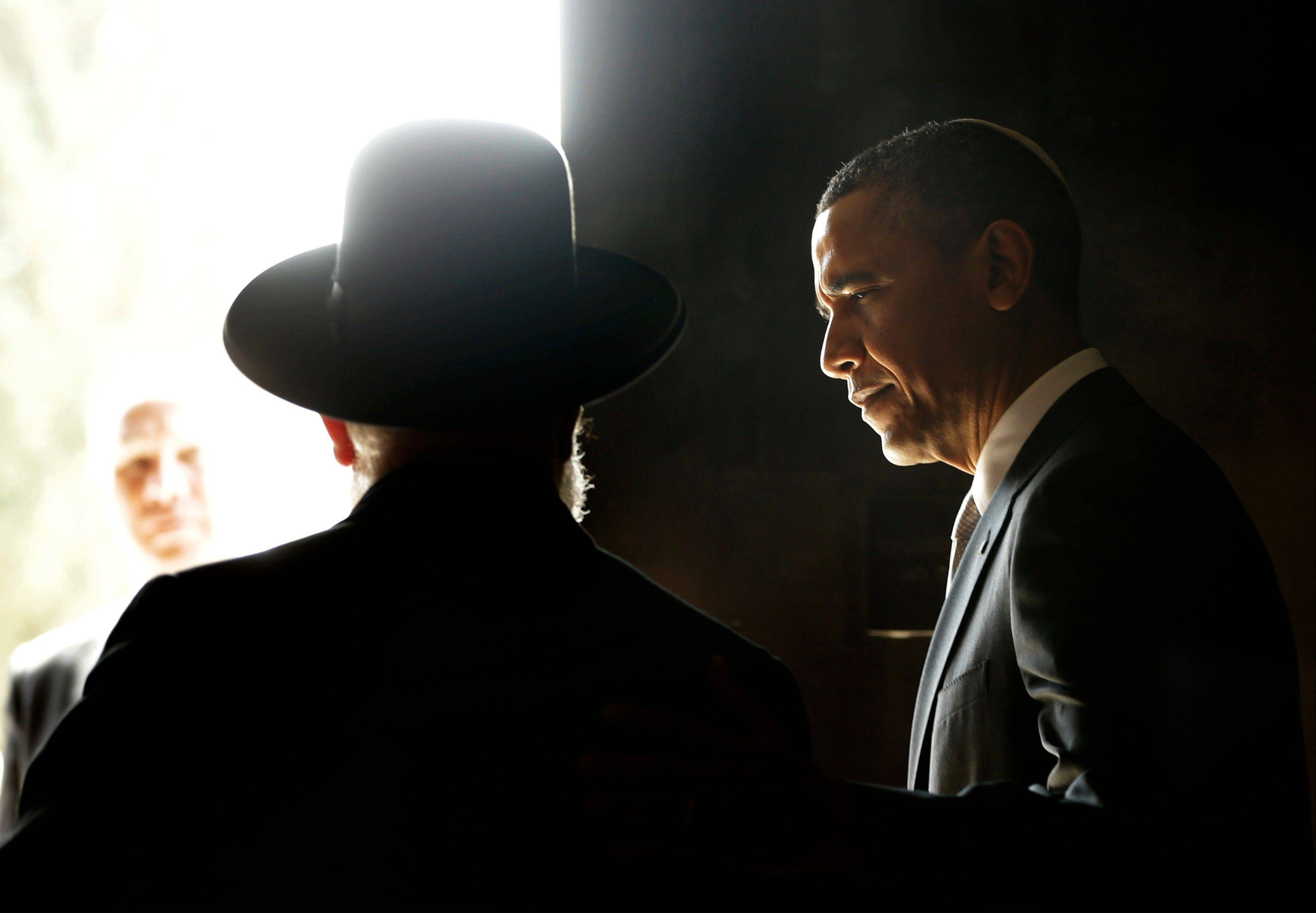 U.S. President Barack Obama, right, walks out with Rabbi Israel Meir Lau, left, after visiting the Hall of Remembrance at the Yad Vashem Holocaust Memorial in Jerusalem, Israel, Friday, March 22, 2013.