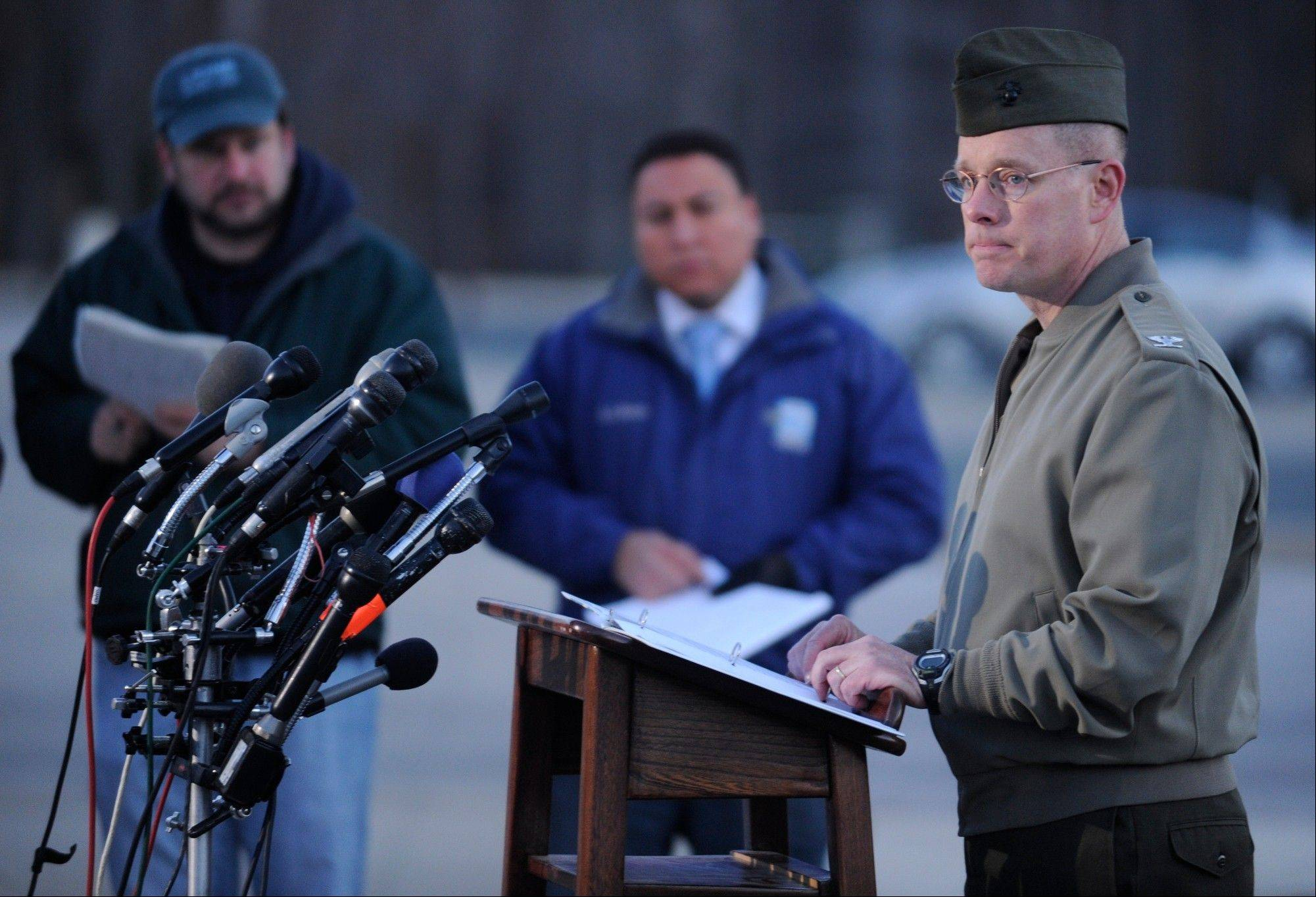 Col. David W. Maxwell holds a news conference at the Marine Corps Museum in Quantico, Va., on Friday, March 22, 2013 regarding a murder-suicide that occurred on Thursday night that resulted in the deaths of three Marines. A Marine killed a male and female colleague in a shooting at a base in northern Virginia before killing himself, officials said early Friday.