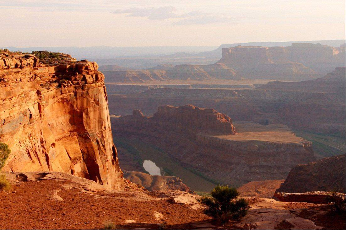 A view at Dead Horse Point State Park near Moab, Utah from the mesa high above the Colorado River where the river has carved a broad horseshoe-shaped bend.