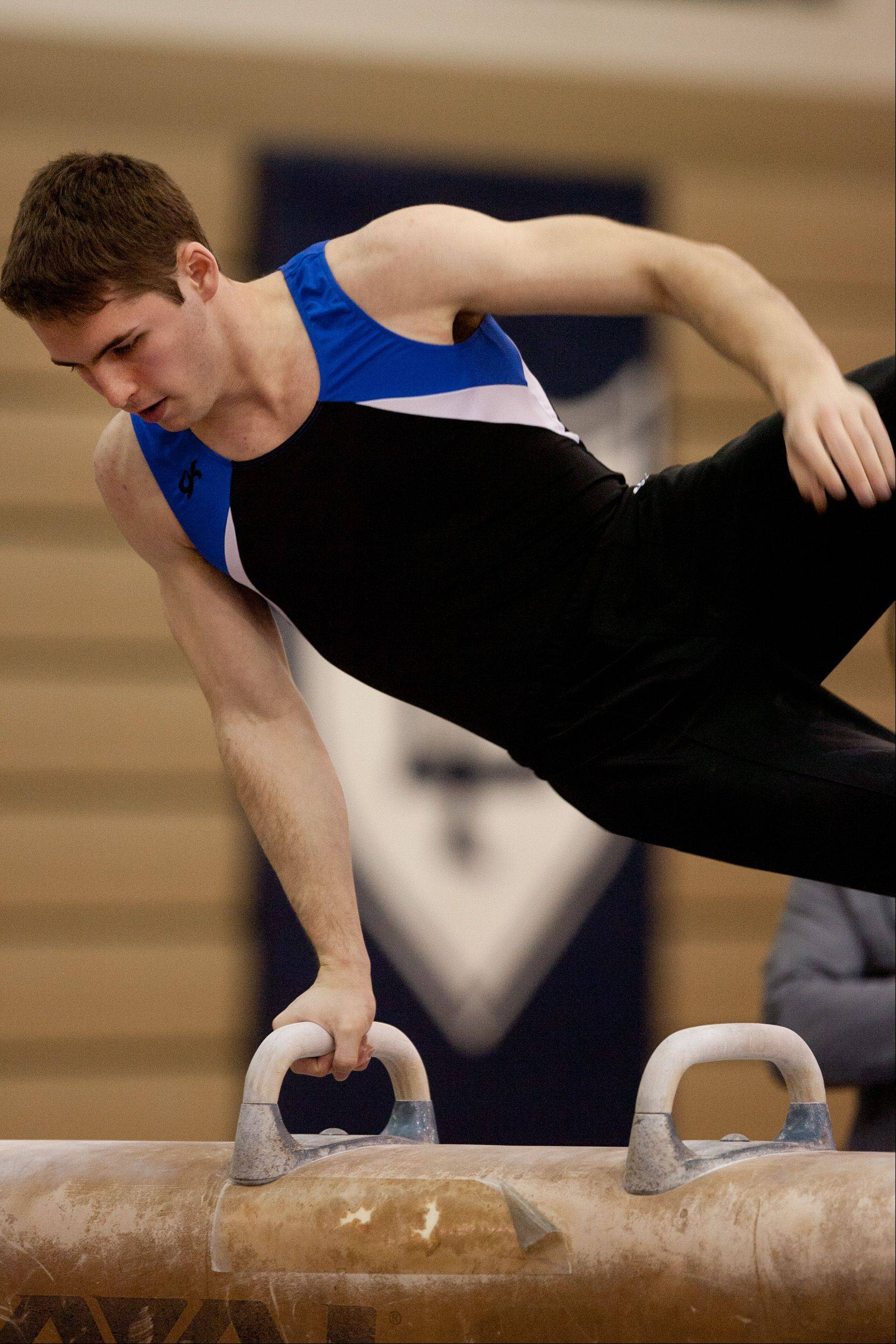 David MacDonald, of the Wheaton CO-OP team, performs his pommel horse routineduring the Lake Park High School Ralph Krupke Boys Gymnastics Invitational.