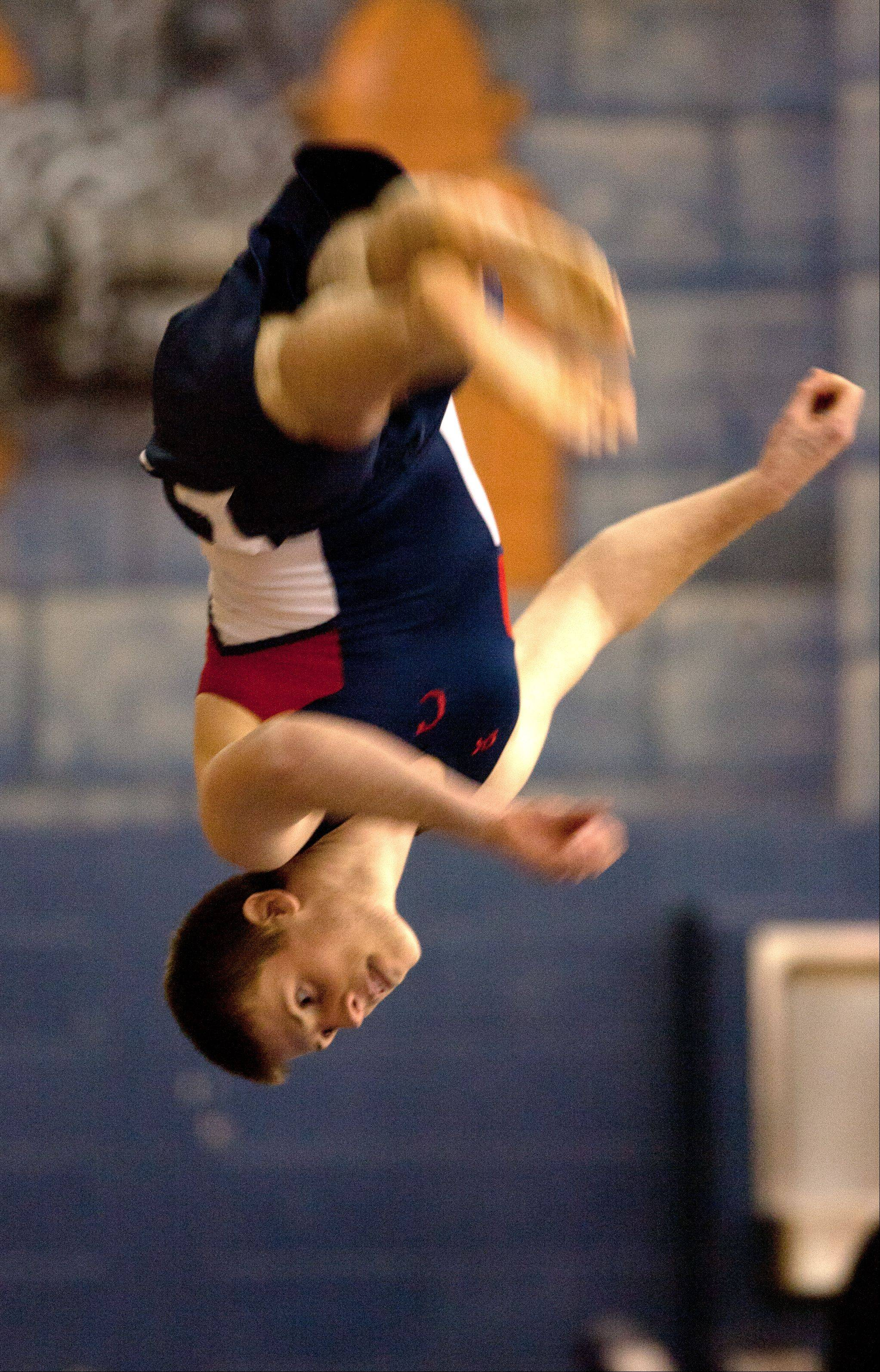 Conant's Josh Hoppe performs his floor excercise routine during the Lake Park High School Ralph Krupke Boys Gymnastics Invitational.