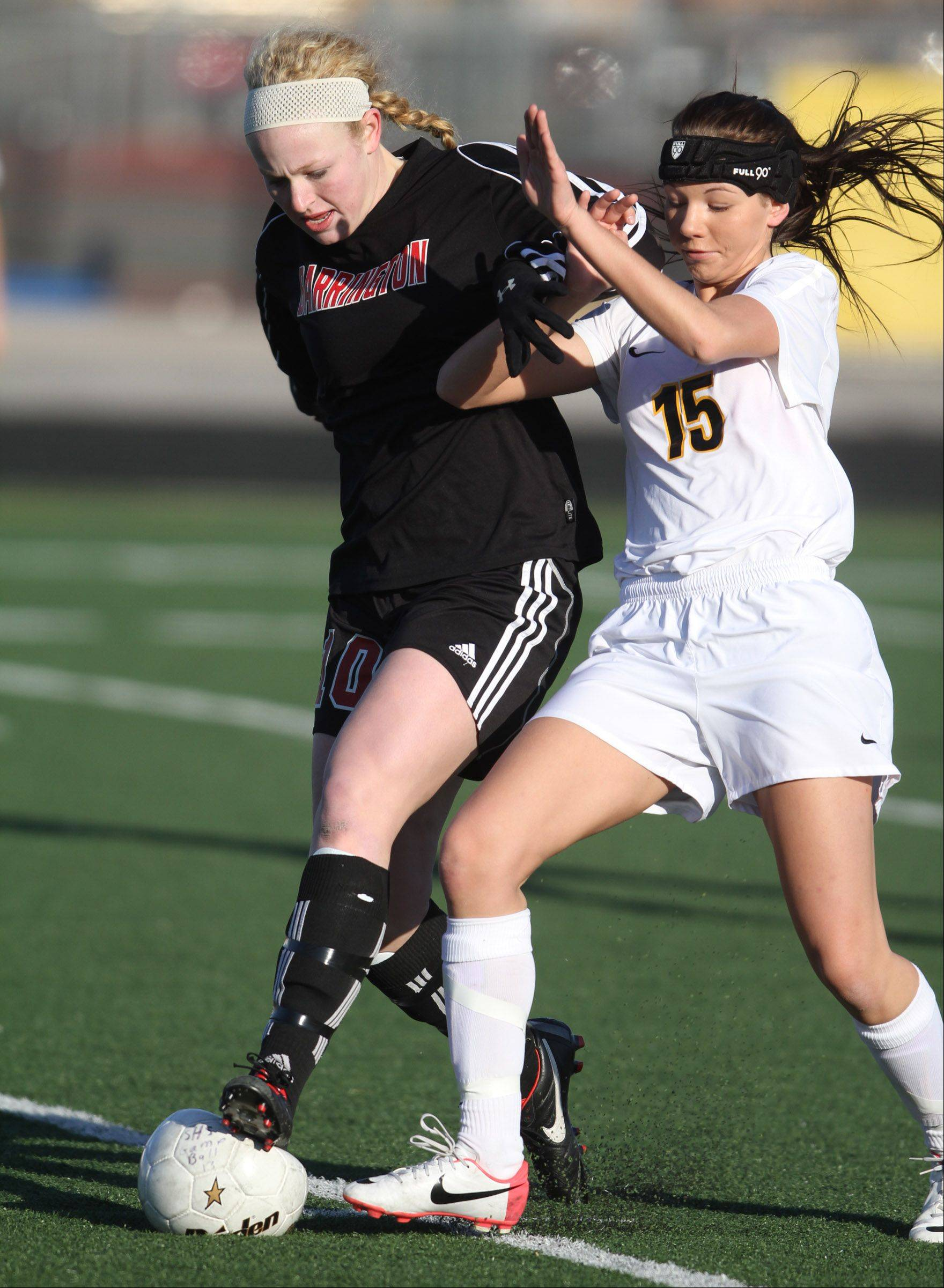 Barrington's Molly Pfeiffer and Schaumburg's Brooke Molitor battle for control of the ball.
