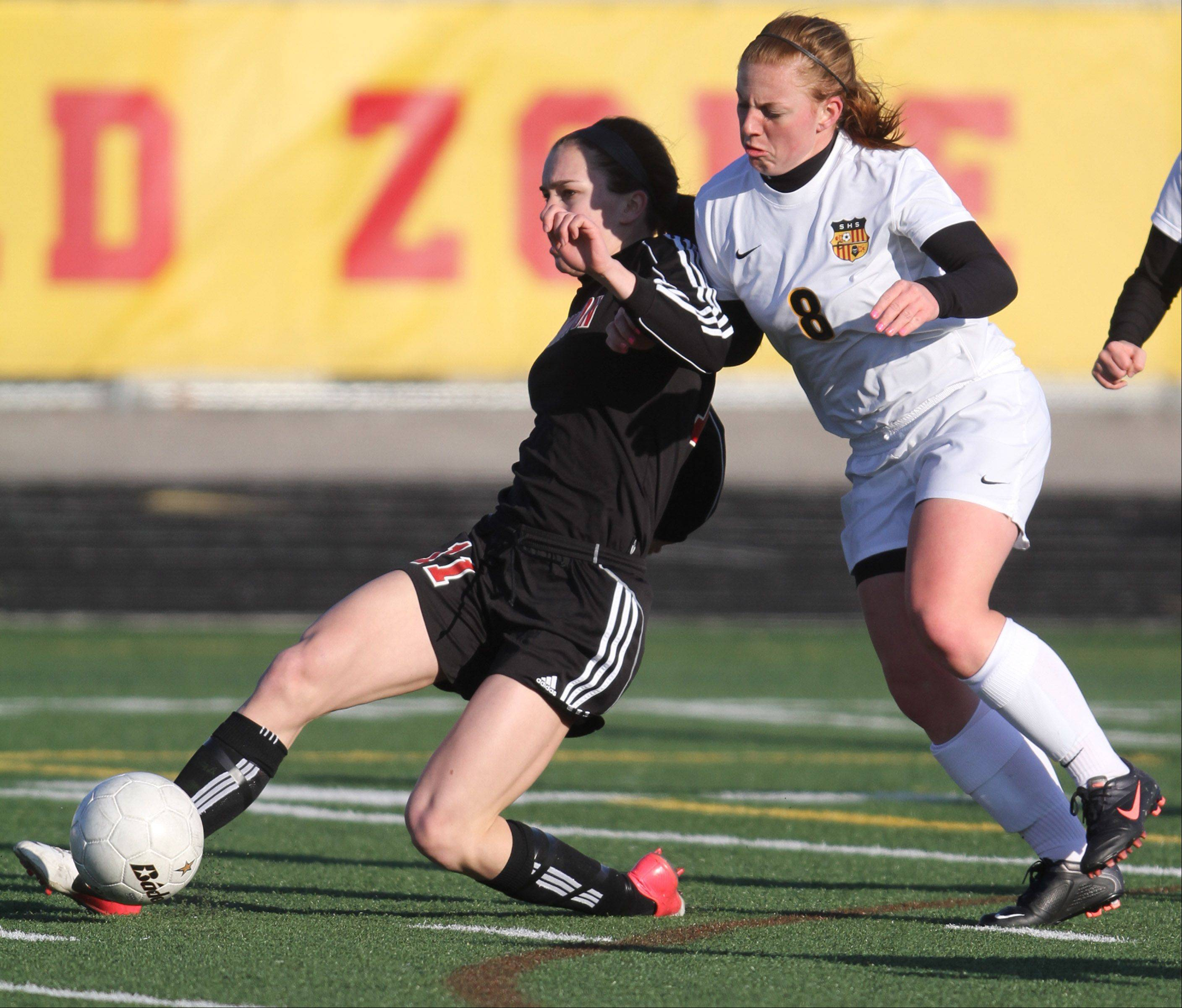 Barrington's Jenna Szczensny battles for the ball with Schaumburg's Emily Longo.
