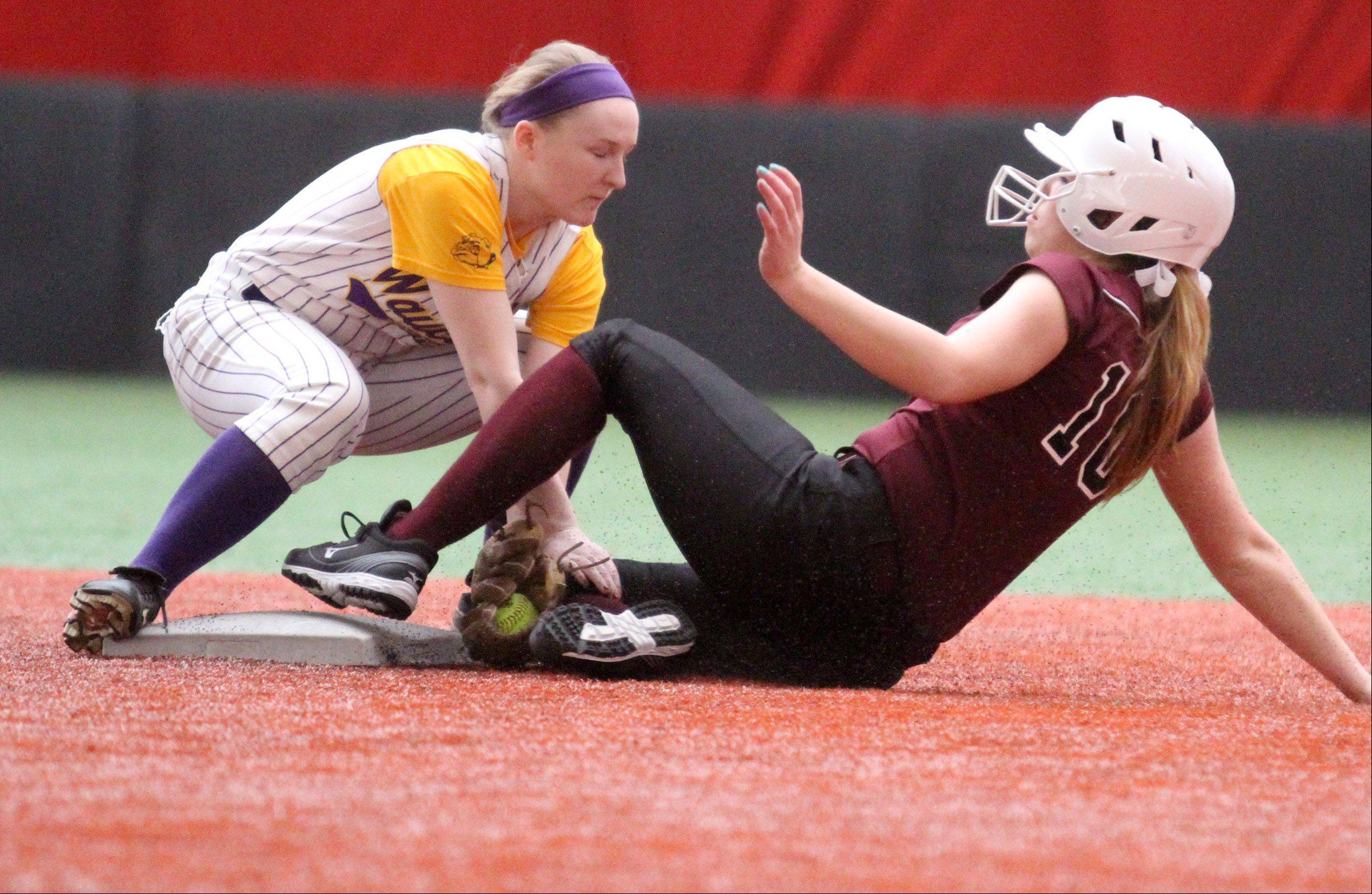 Marengo's Megan Semro slides out into second base as Wauconda's Lauren Nee applies the tag at The Dome in Rosemont on Friday, March 22, 2013.