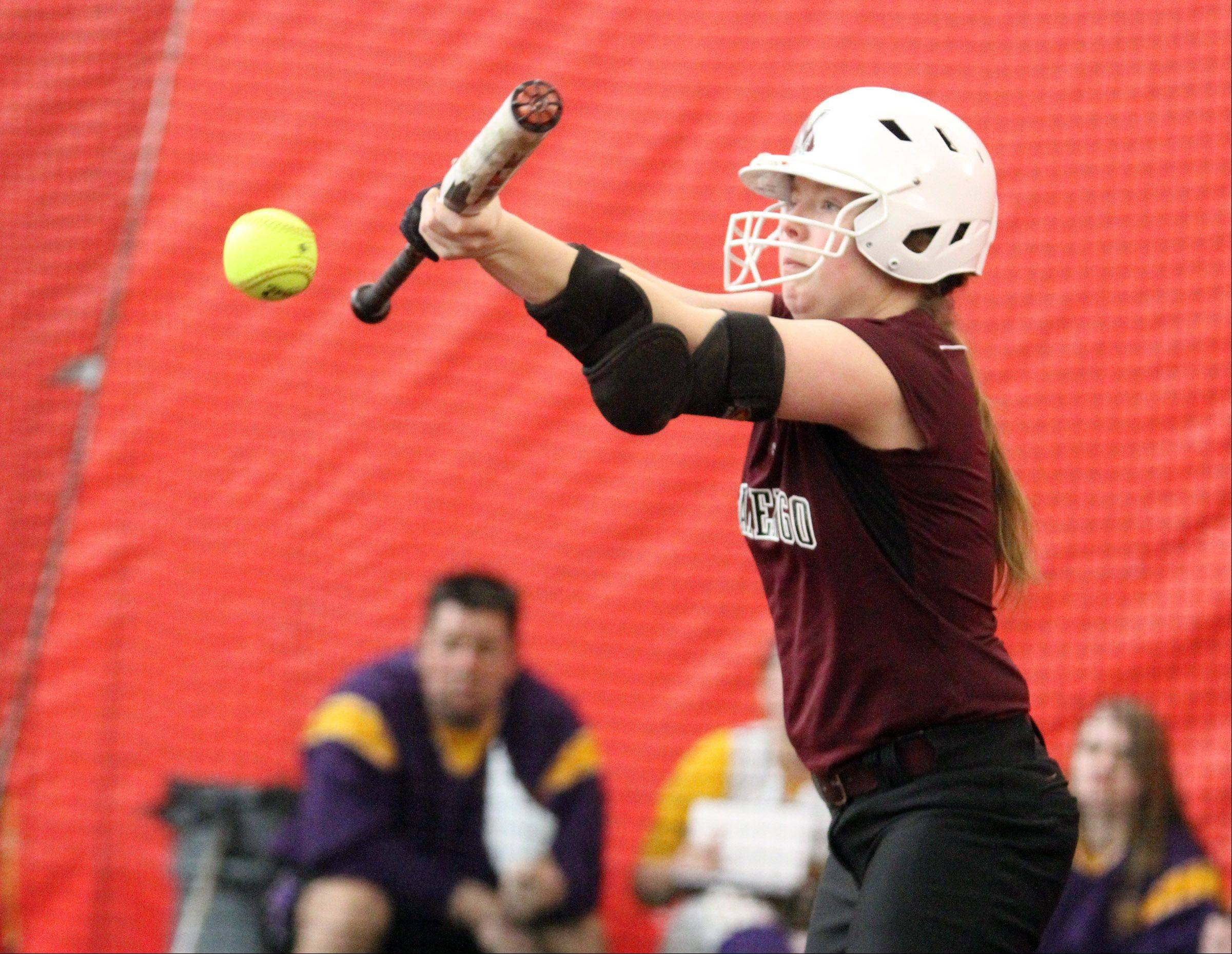 George LeClaire/gleclaire@dailyherald.comMarengo's Abby Kissack bunts the ball against Wauconda pitcher Kayla Wedl at The Dome in Rosemont on Friday, March 22, 2013.