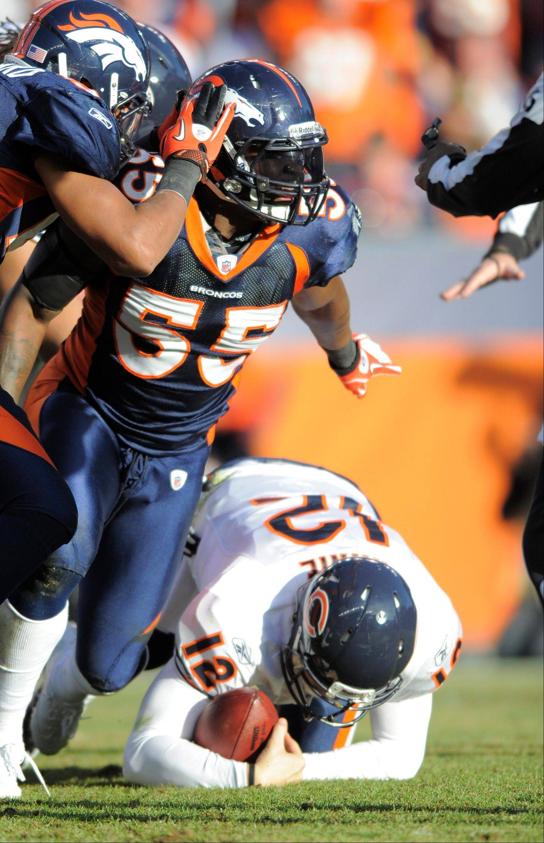 Denver Broncos linebacker D.J. Williams (55) celebrates after sacking Bears quarterback Caleb Hanie in their Dec. 11, 2011 contest at Soldier Field.