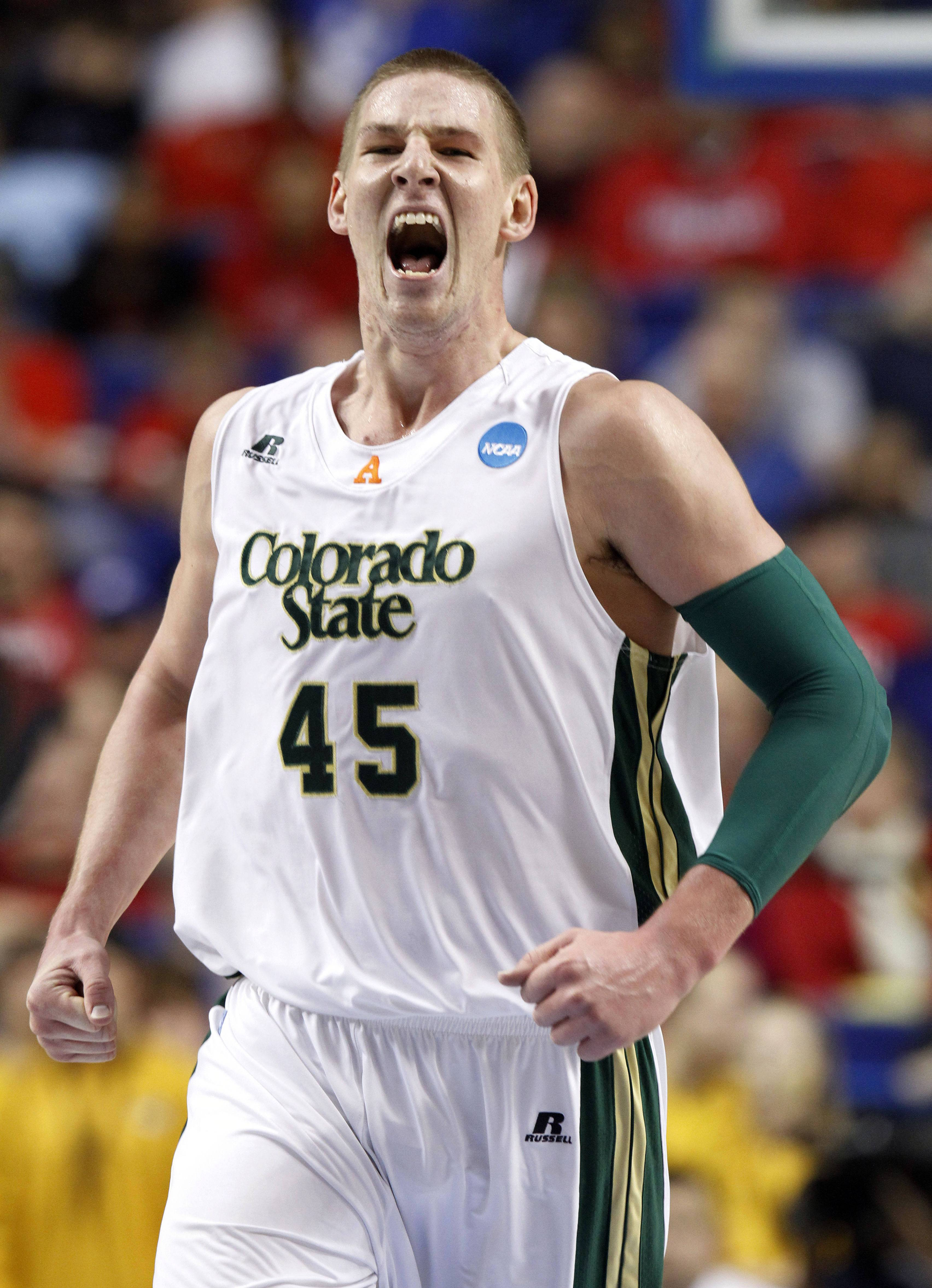Colorado State's Colton Iverson (45) reacts after a basket during the first half of their second-round NCAA college basketball tournament game against Missouri, Thursday, March 21, 2013, in Lexington, Ky.