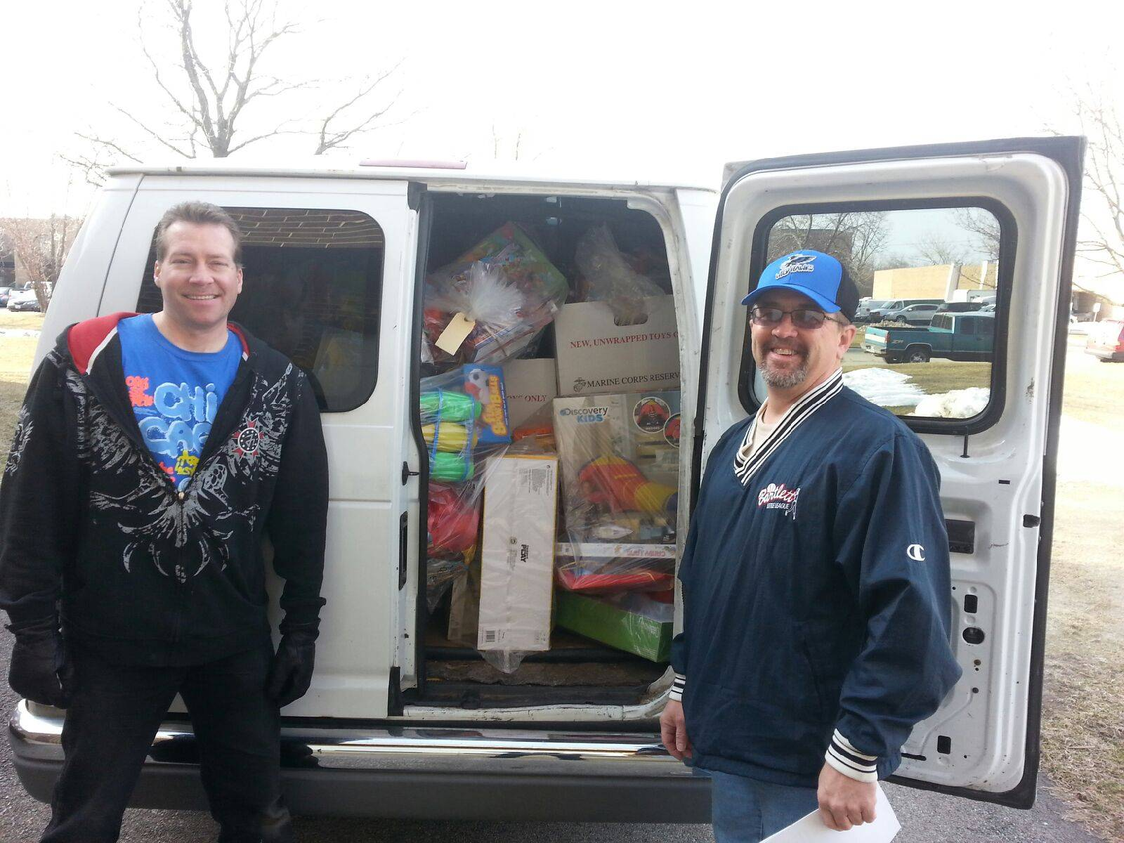 HSP volunteers Jeff Marker (left) and Dean Senne (right,) ready to take a van load of gifts to the children at Two Rivers Head Start's East Aurora location