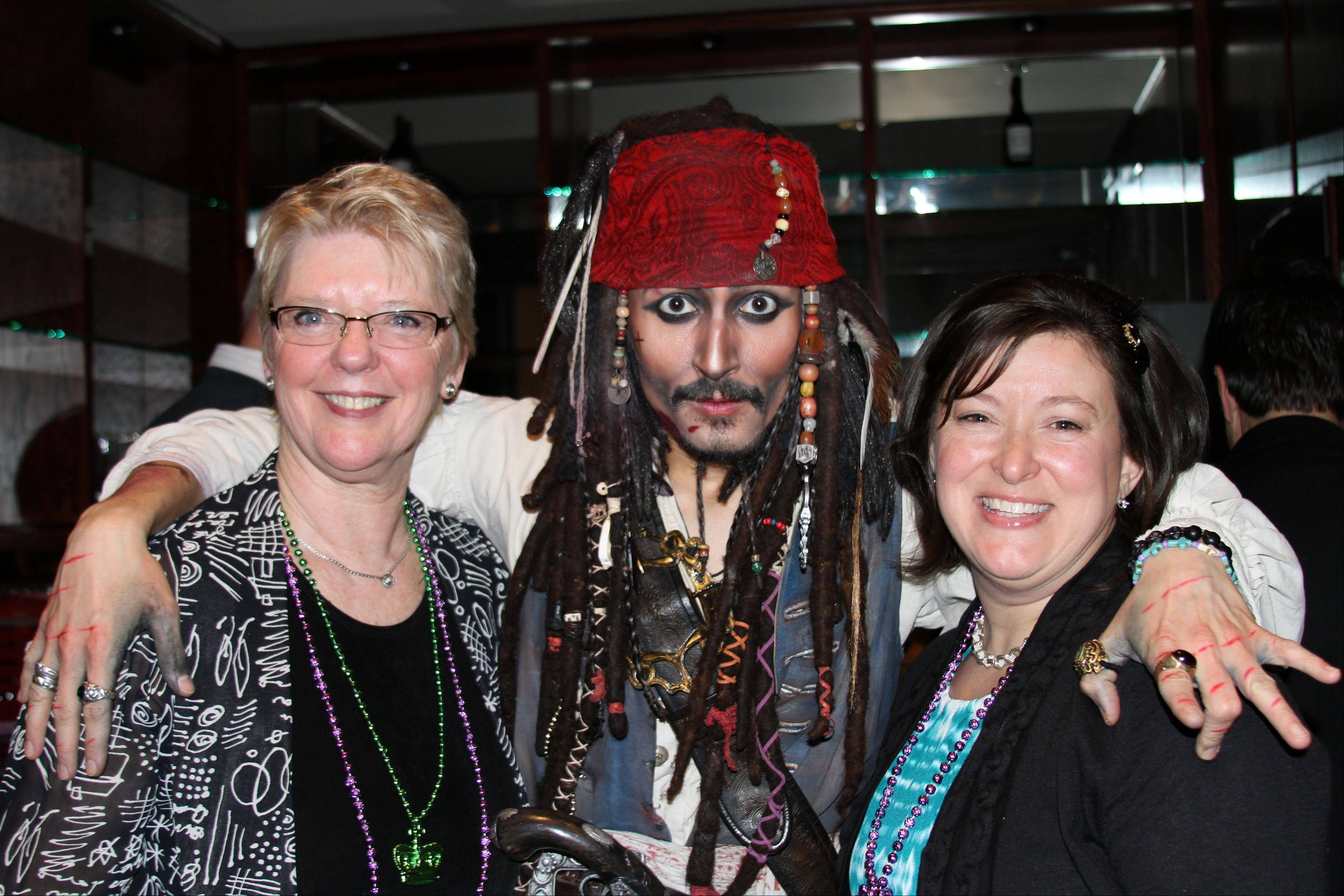 Foundation secretary Donna Anderson, Jack Sparrow impersonator Rick Aspen and District 54 board member Mary Kay Prusnick at the Schaumburg Township Elementary School Foundation's 12th annual Mardi Gras gala.