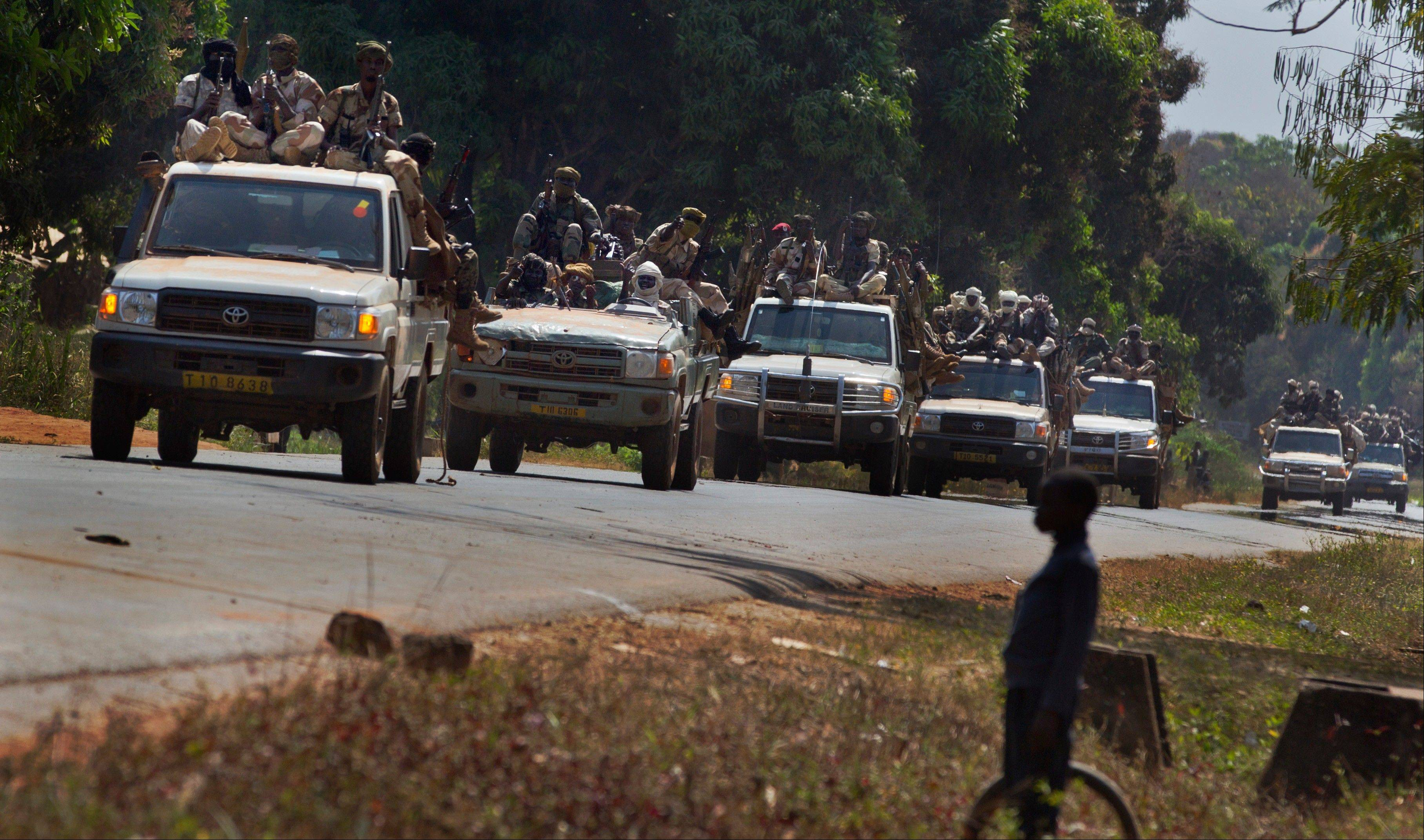 A convoy of Chadian soldiers fighting in support of Central African Republic president Francois Bozize moves along the road in Damara last January. On Friday, rebels took the town and began a new march to take the capital, Bangui.