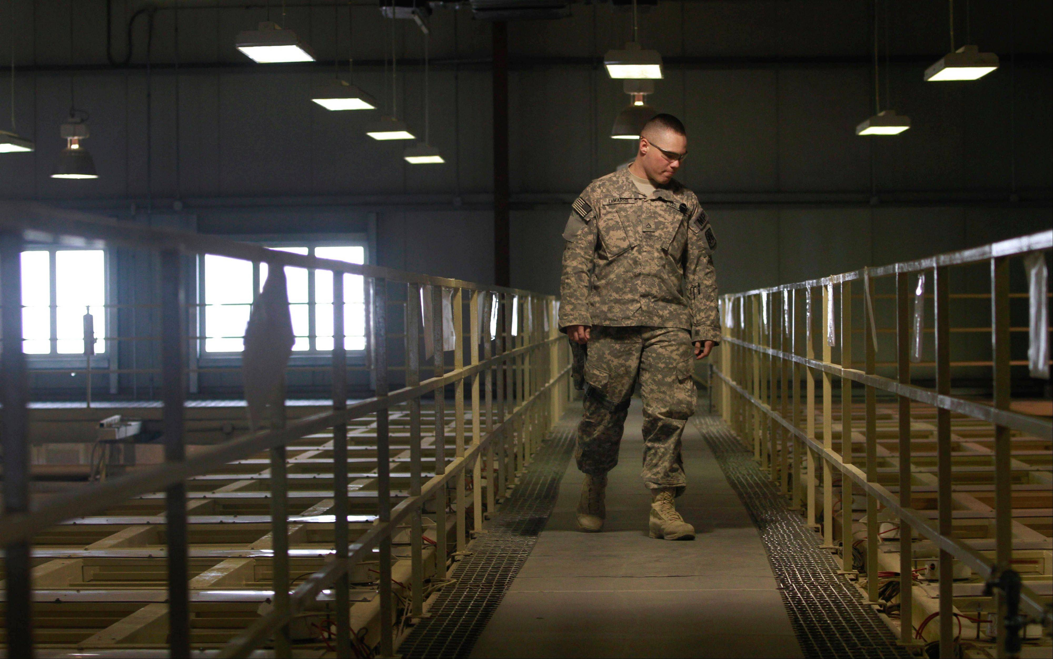 Associated Press/March 23, 2011 A U.S. military guard watches over detainee cells inside the Parwan detention facility near Bagram Air Field in Afghanistan.