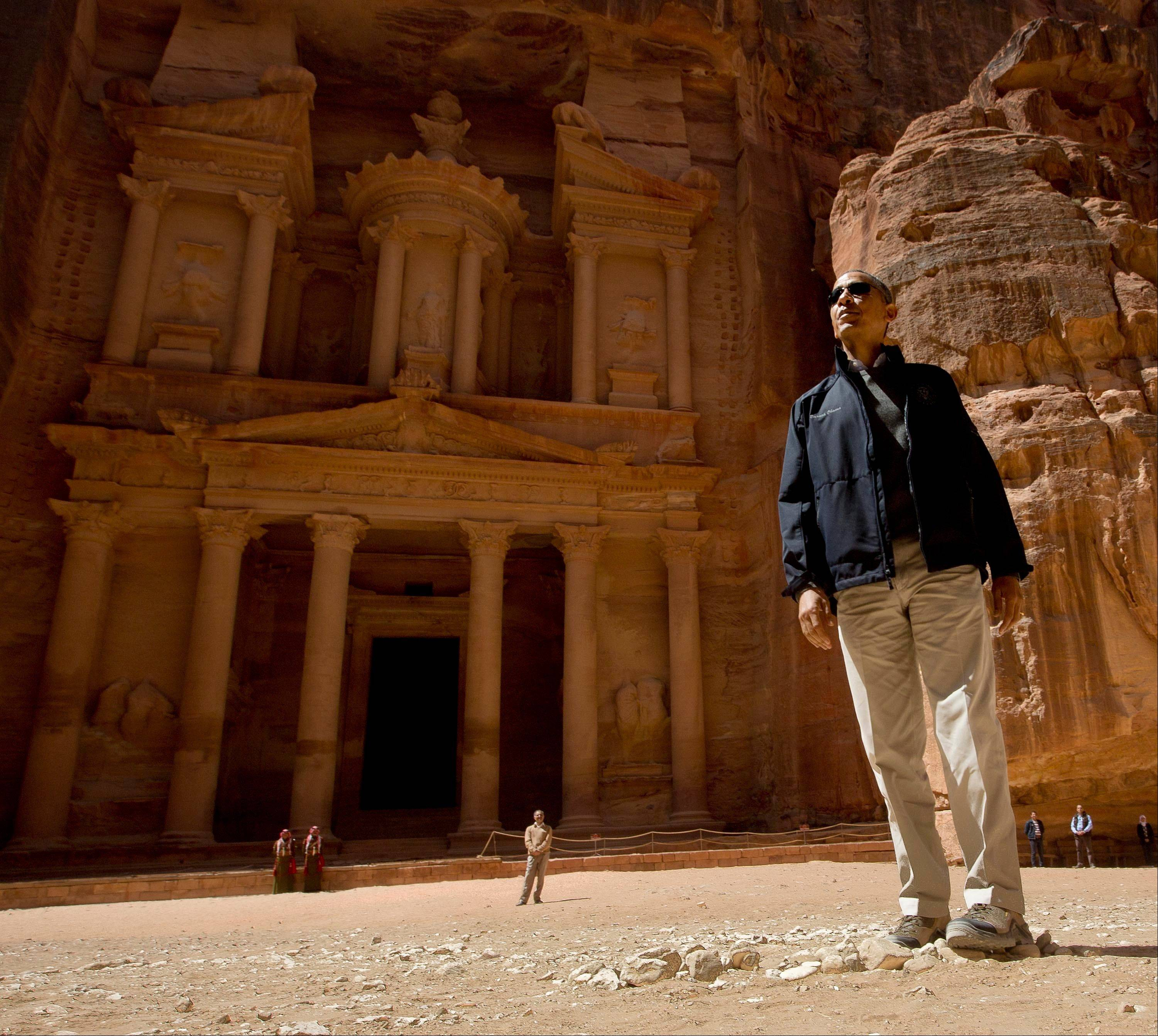 President Barack Obama stops to look at the Treasury Saturday during his tour of the ancient city of Petra in Jordan.