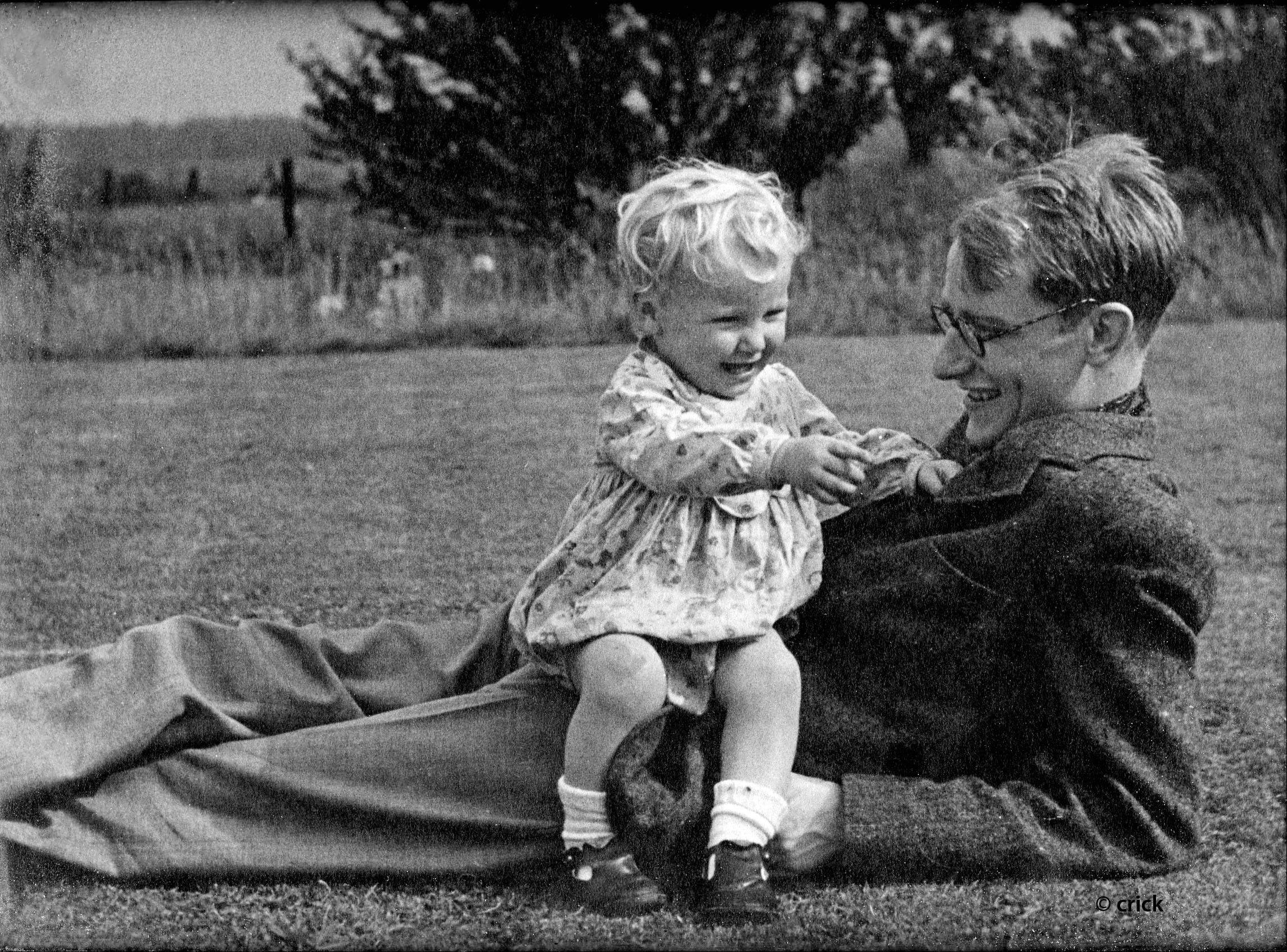 In this circa 1943 photo provided Michael Crick, Michael sits on his father Francis Crick in Northampton, England.