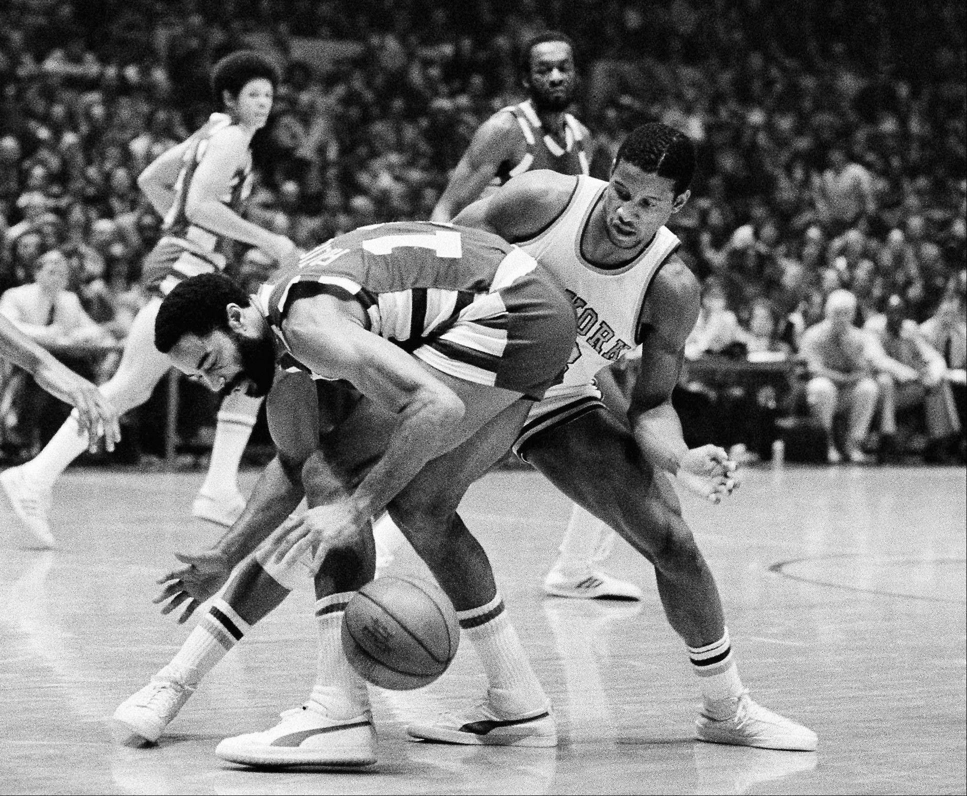 Associated Press/Oct. 25, 1977 Cleveland Cavaliers� Walt Frazier, left, and New York Knicks� Ray Williams vie for the ball during the second half of an NBA basketball game at New York�s Madison Square Garden.
