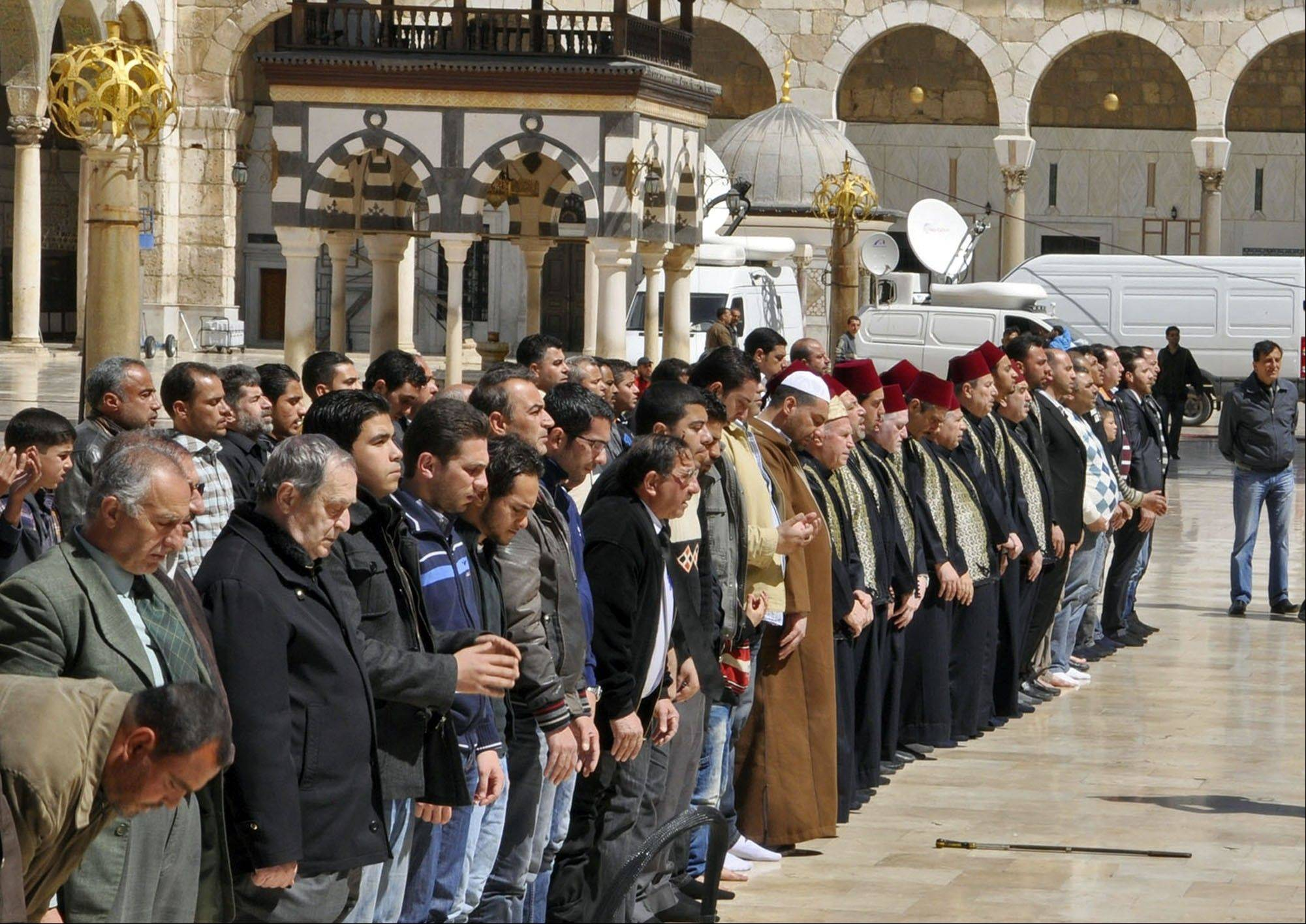 Mourners pray Saturday during the funeral of Sheik Mohammad Said Ramadan al-Buti, an 84-year-old pro-government cleric in the courtyard of the eighth century Omayyad Mosque, in Damascus, Syria. Al-Buti, his grandson and scores of others were killed Thursday when a suicide bomber detonated his explosives inside a mosque.