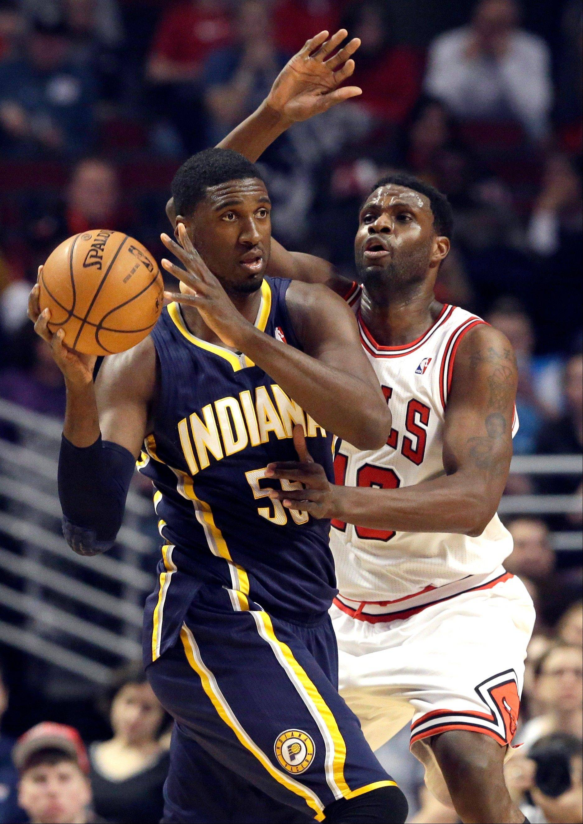 Bulls center Nazr Mohammed plays some tight defense on the Pacers� Roy Hibbert on Saturday night at the United Center.
