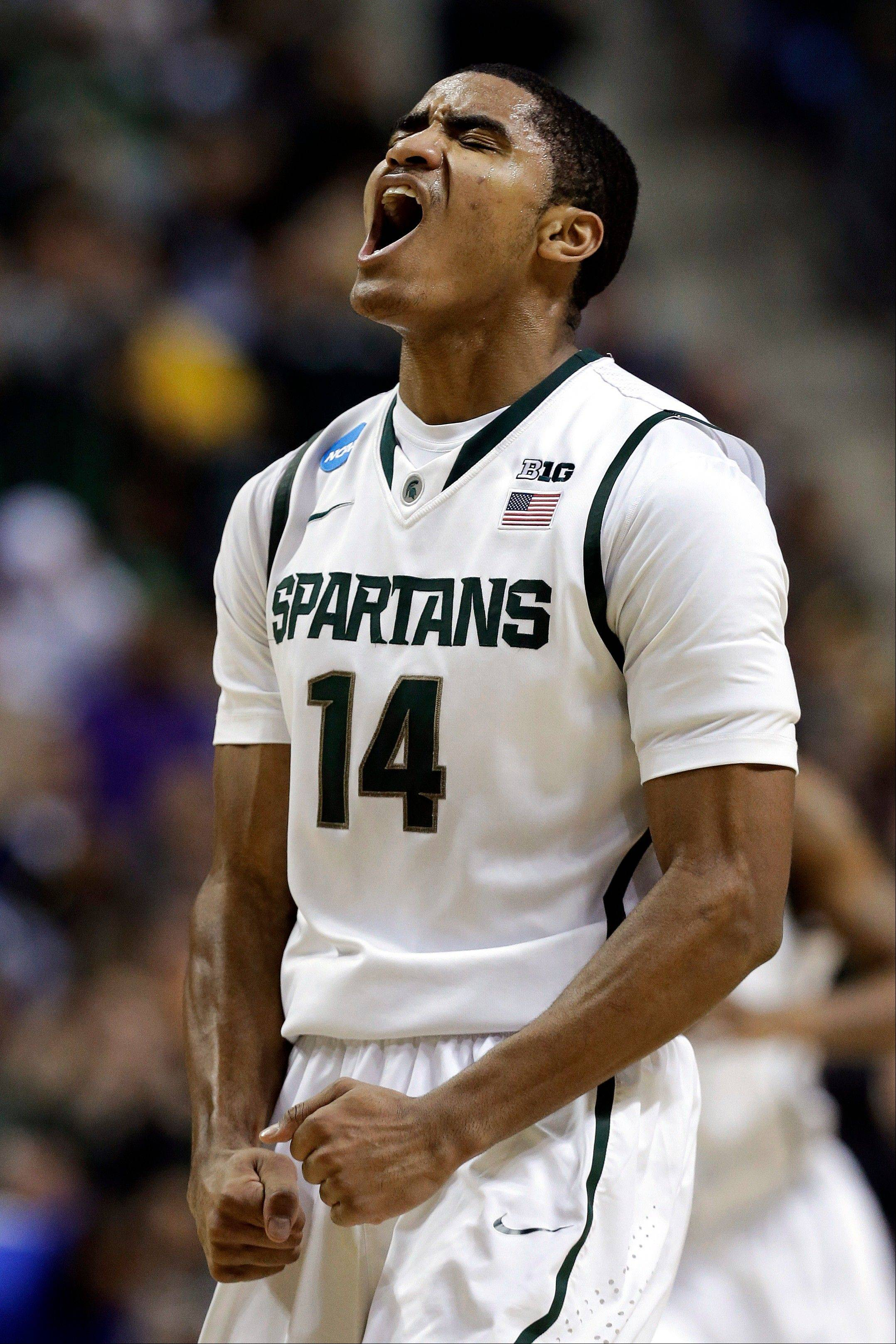 Michigan State guard Gary Harris reacts to hitting a 3-pointer against Memphis in the first half of their third-round game of the NCAA college basketball tournament in Auburn Hills, Mich., Saturday March 23, 2013. (AP Photo/Paul Sancya)