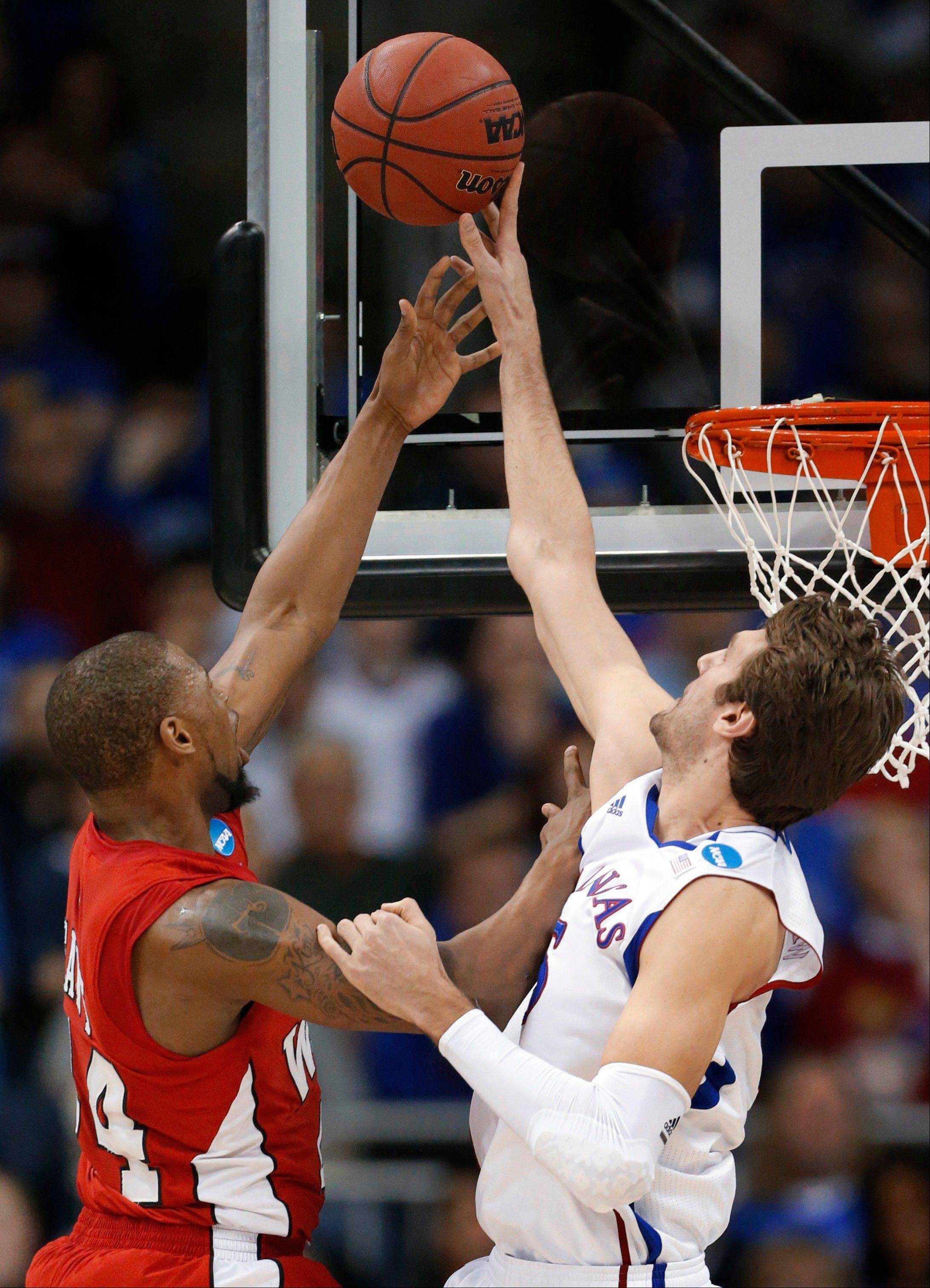 Kansas center Jeff Withey (5) blocks a shot by Western Kentucky forward George Fant (44) during the first half of a second-round game in the NCAA men's college basketball tournament in Kansas City, Mo., Friday, March 22, 2013. (AP Photo/Orlin Wagner)
