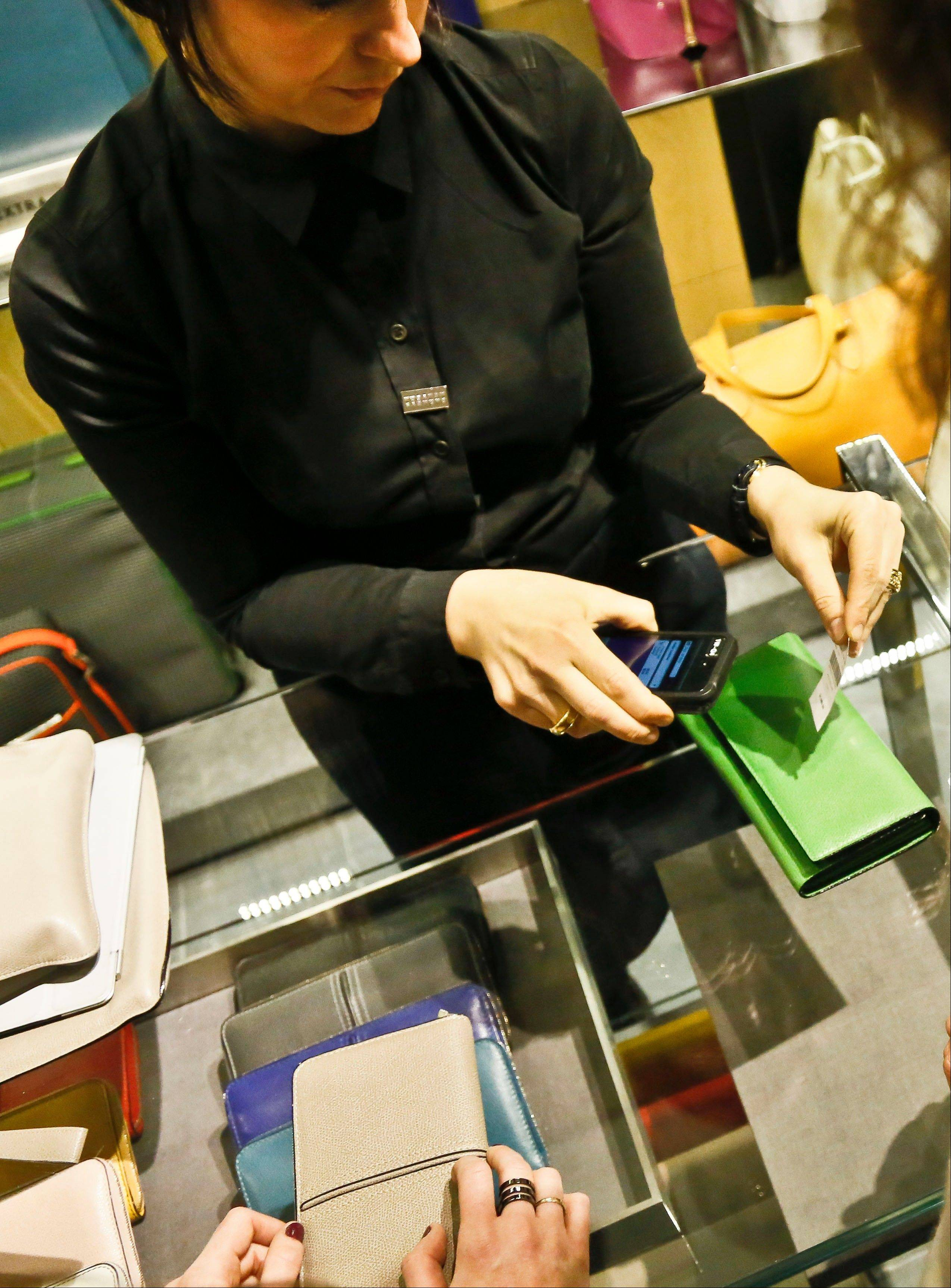 Stores across the country are ditching the old-fashioned, clunky cash registers and instead having salespeople -- and shoppers themselves -- checkout on smartphones and tablet computers.