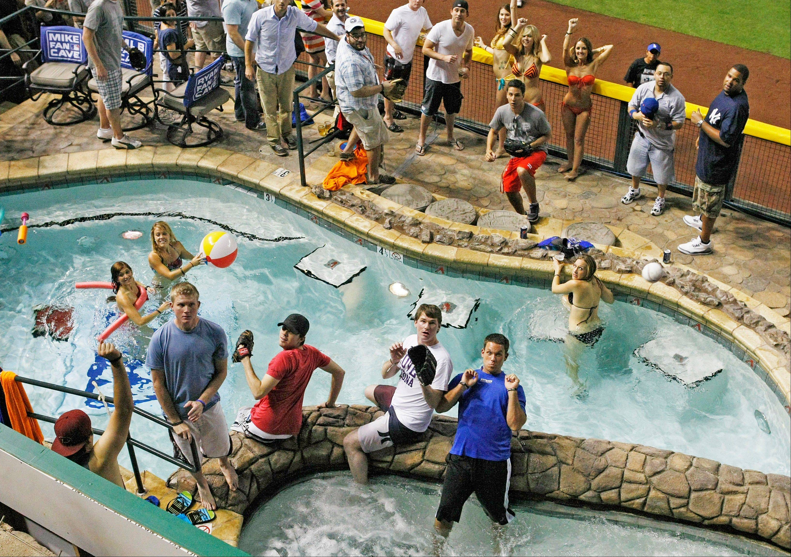 A home-run ball falls into the pool during the All-Star Home Run Derby at Chase Field in Phoenix.