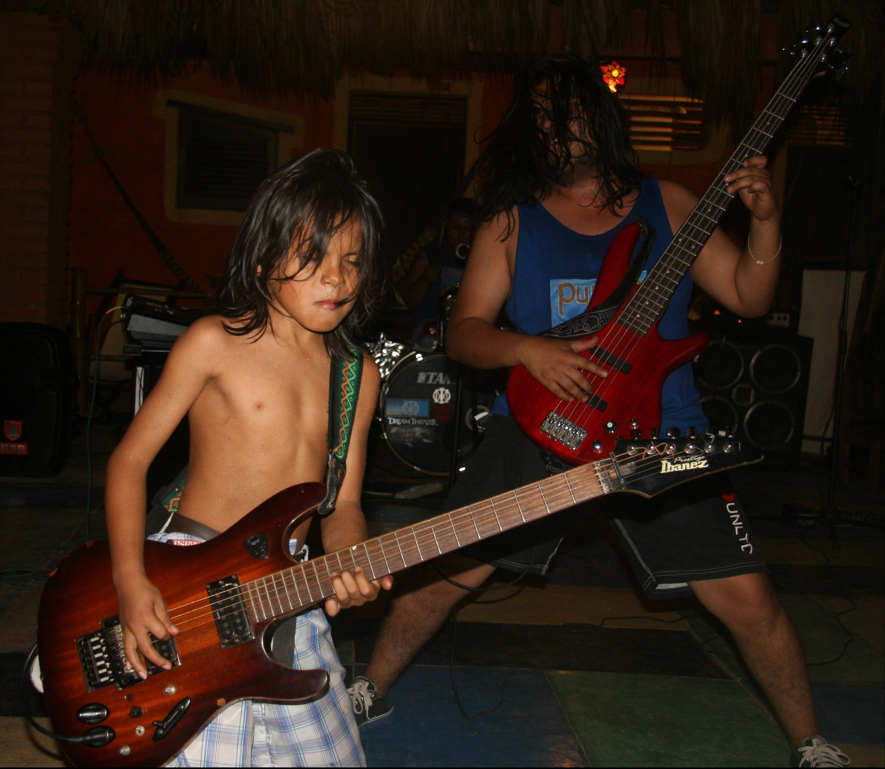 Child guitar prodigy Cainn Cruz, left, performs at the Posada Mexico restaurant in Zipolite, Mexico. The oceanfront restaurant offers a variety of live entertainment.