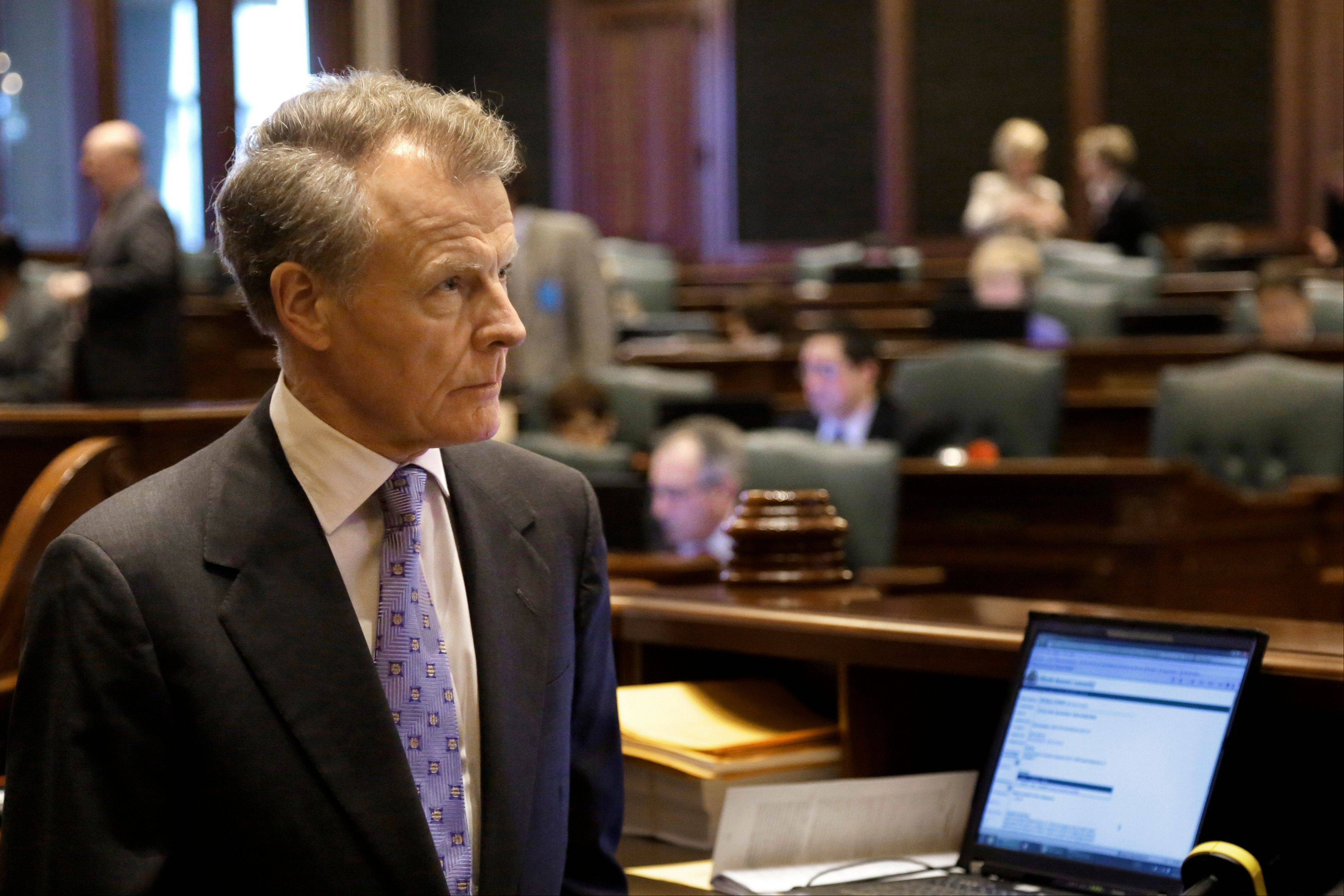 Illinois Speaker of the House Michael Madigan listens Tuesday to lawmakers argue gun legislation on the House floor.