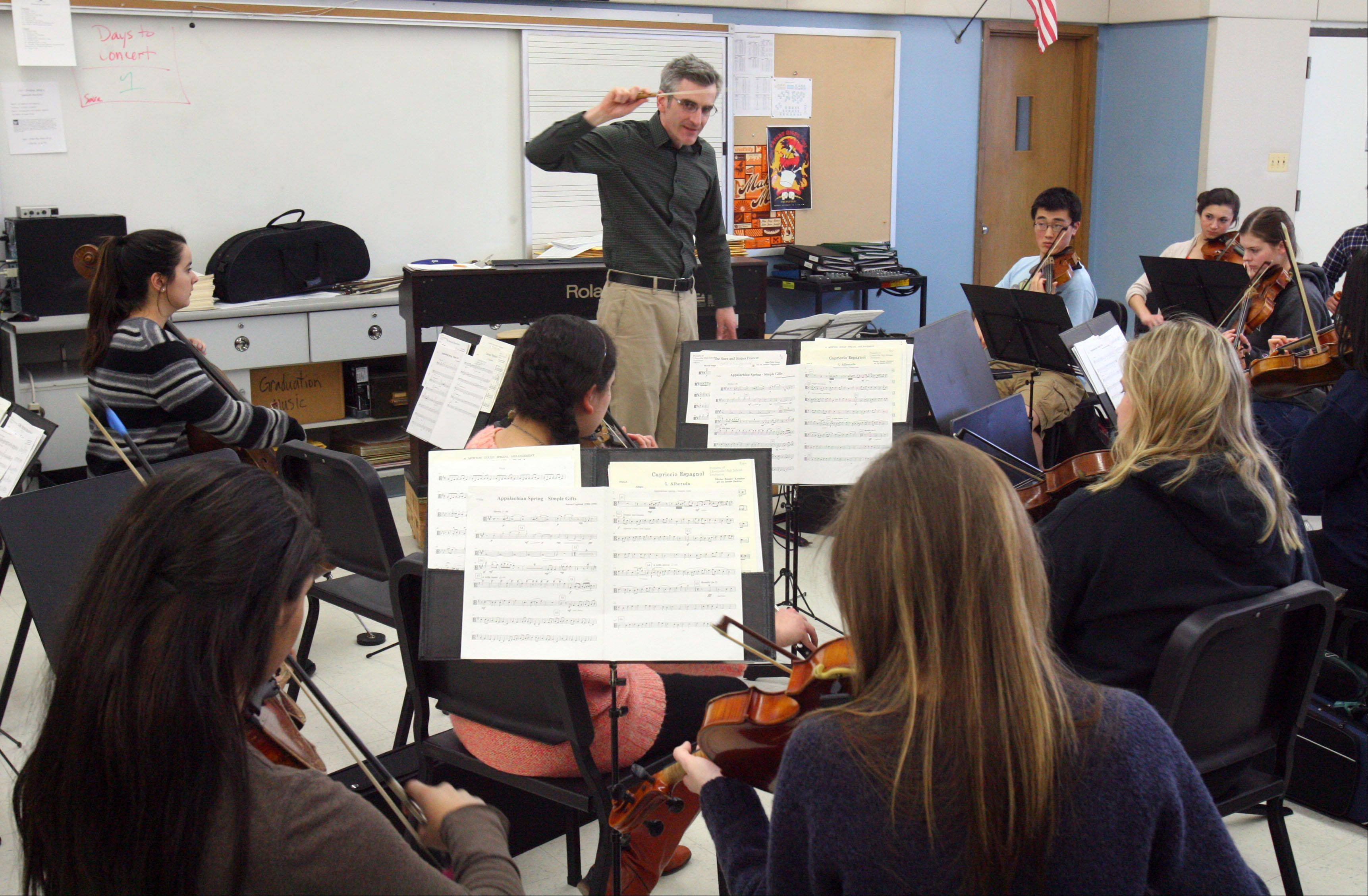 Libertyville High School orchestra director Jeremy Marino leads musicians as they rehearse for their trip to Cuba. The school's musicians have performed around the world through the years, but this is the first trip to Cuba.