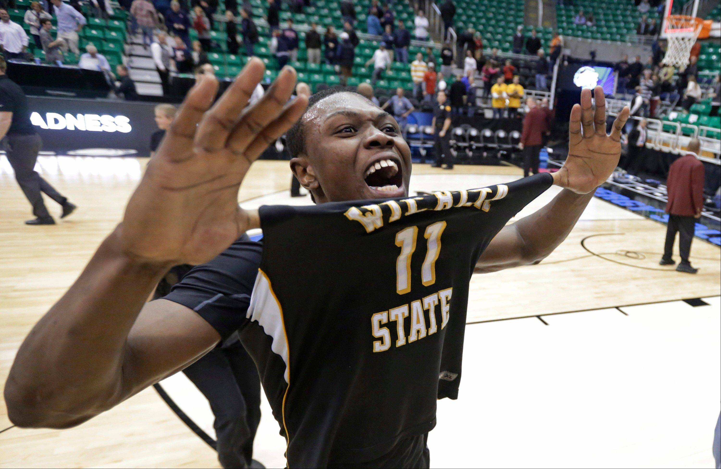 Wichita State's Cleanthony Early (11) celebrates his team defeating Gonzaga 76-70 during a third-round game in the NCAA men's college basketball tournament Saturday night in Salt Lake City.