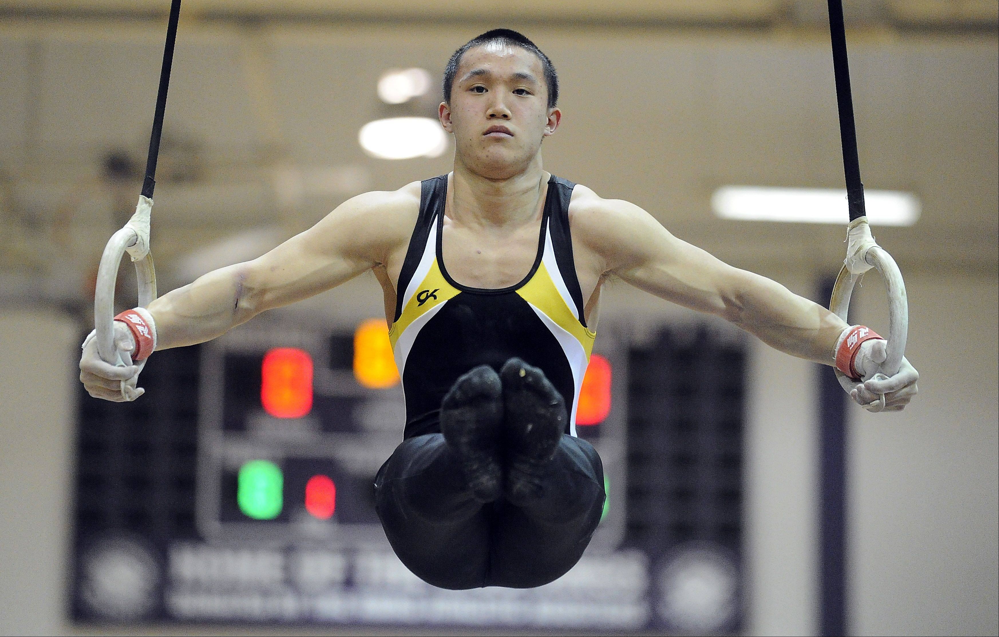 Mark Welsh/mwelsh@dailyherald.comGlenbard North's Derrick Nguyen works the still rings at the Vic Avigliano Mustang Gymnastics Invitational at Rolling Meadows High School on Saturday.