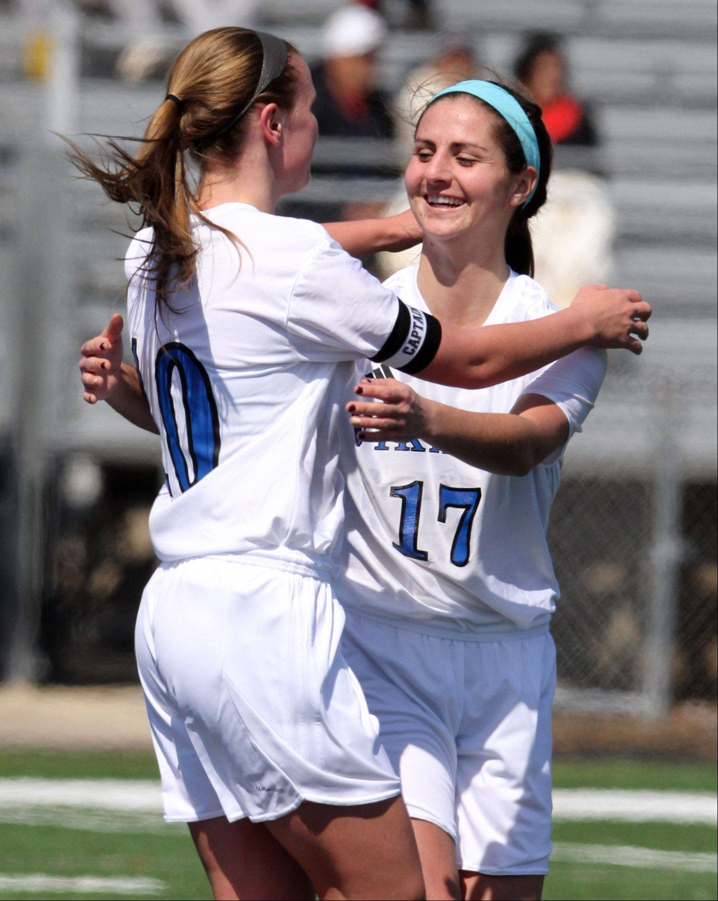 Geneva's Amanda Lulek, left, gets a hand after scoring by Molly Stanfa, who assisted, at Geneva on Saturday, March 23, 2013.