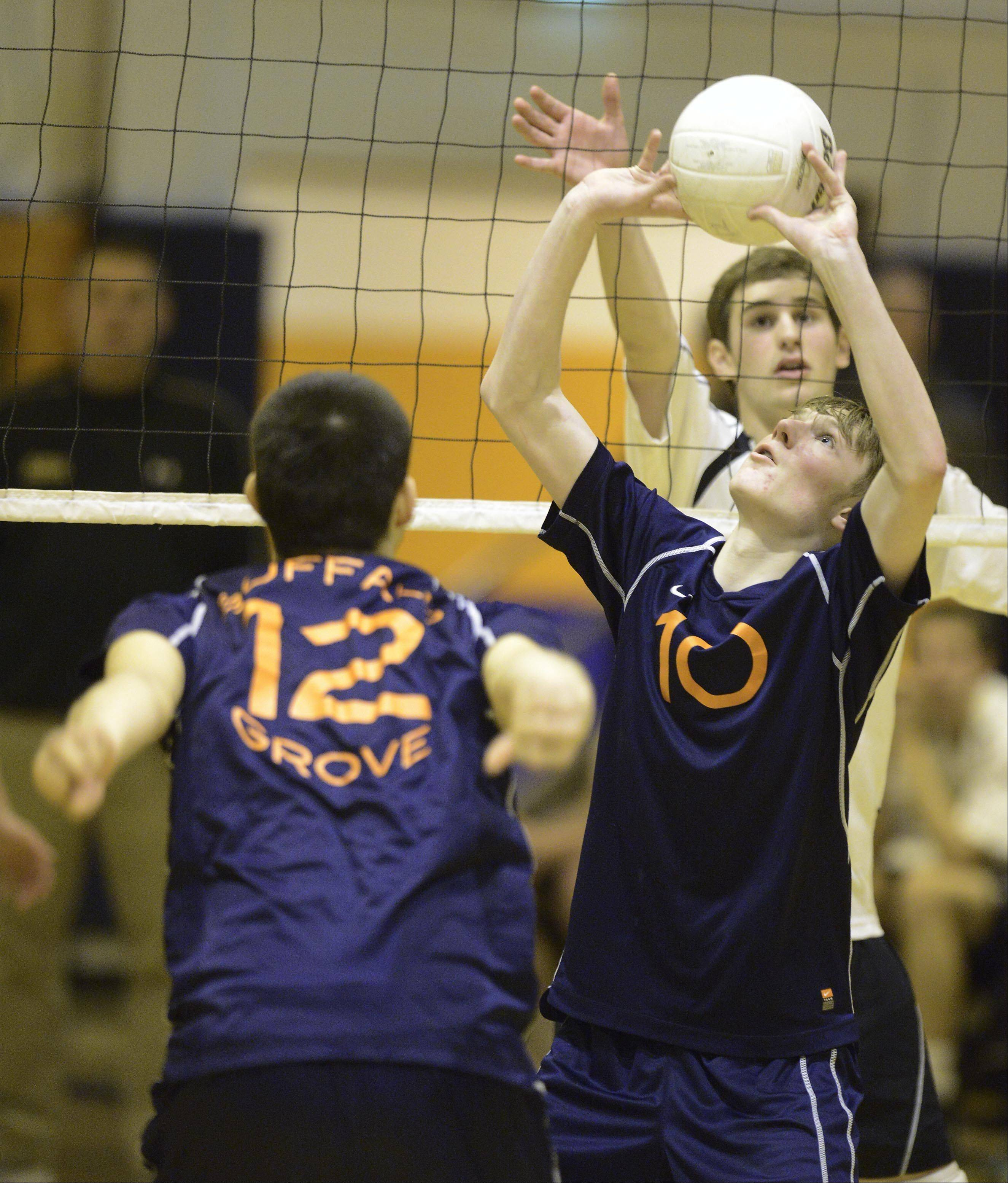 Buffalo Grove's Kevin Shanahan, right, sets the ball as teammate Jose Aguirre gets ready for a kill during the Buffalo Grove boys volleyball invite Saturday.