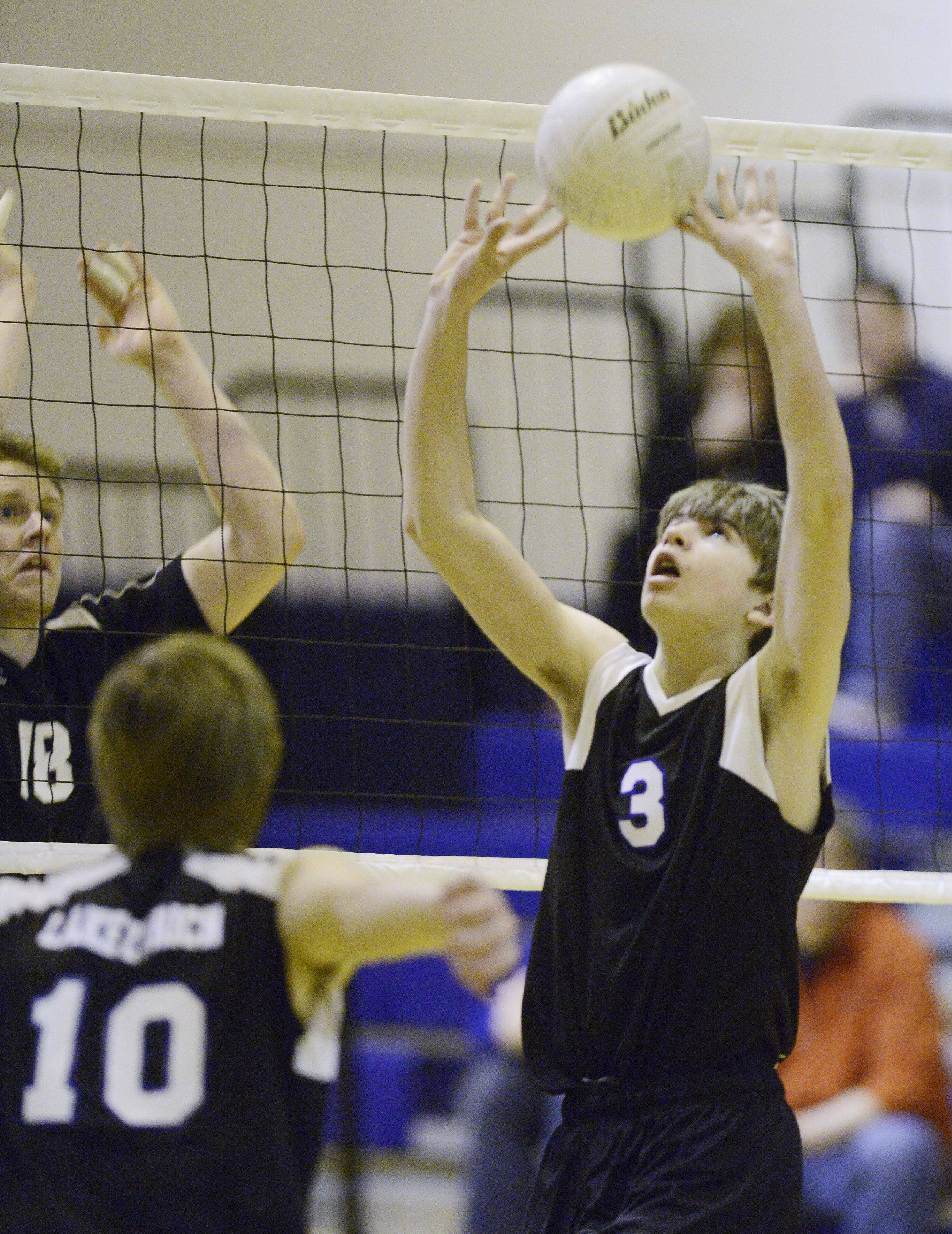 Lake Zurich's Pat Bush sets the ball during Saturday's game against Wheaton-Warrenville South at the Buffalo Grove boys volleyball invite.