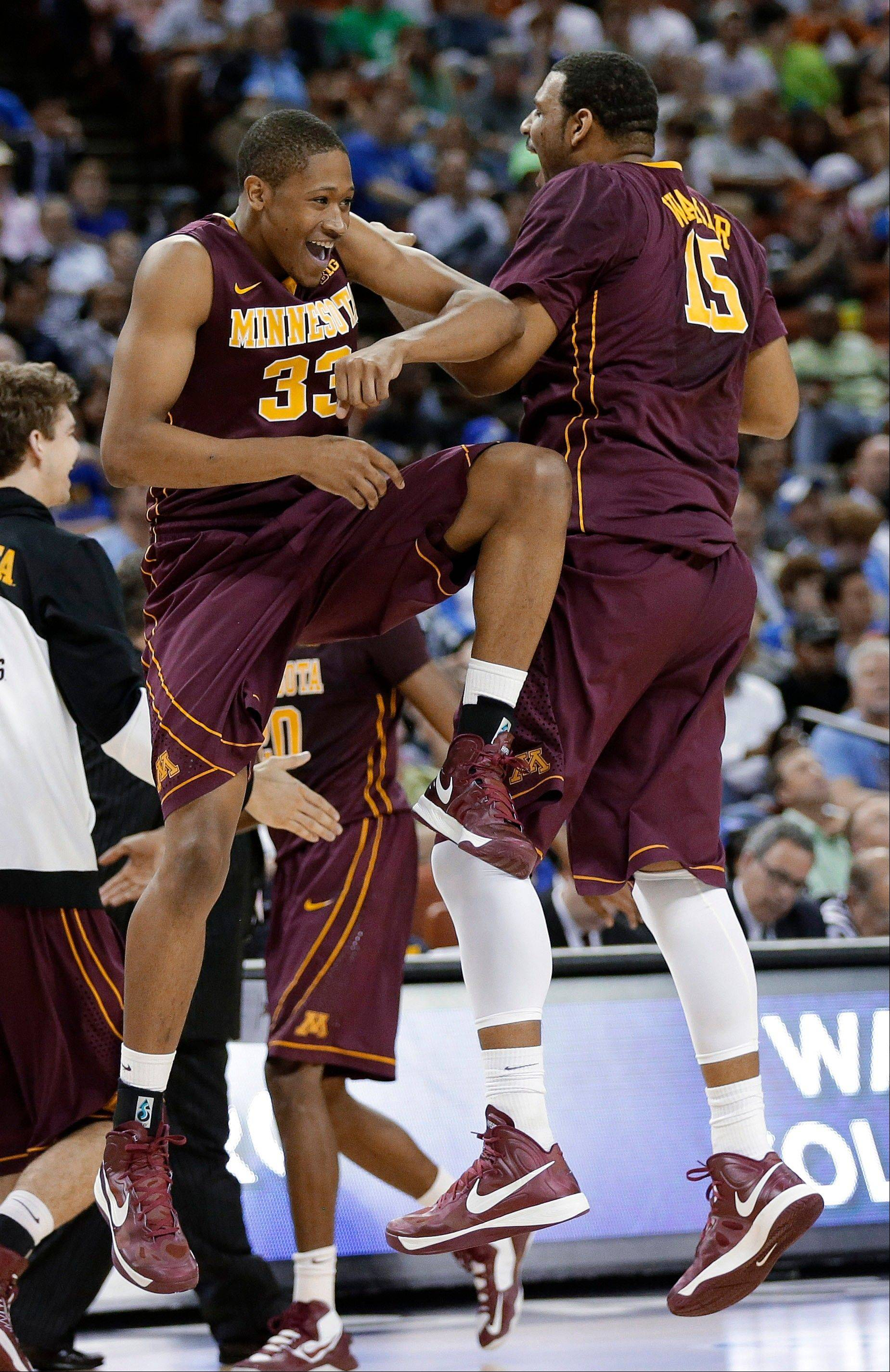 Minnesota's Rodney Williams (33) and Maurice Walker (15) celebrate during a timeout during the first half against UCLA in a second-round game of the NCAA college basketball tournament Friday, March 22, 2013, in Austin, Texas.