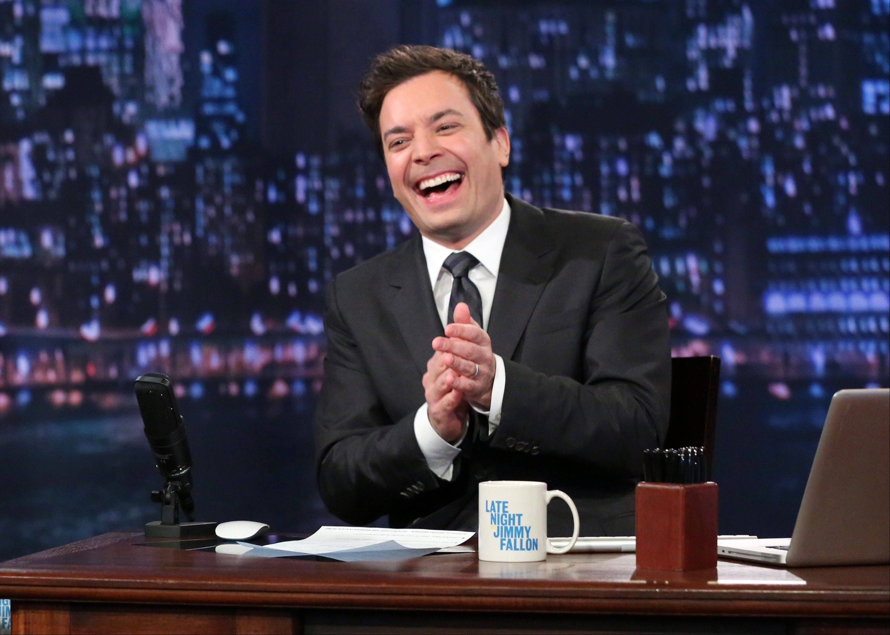 This Feb. 21, 2013 photo released by NBC shows Jimmy Fallon, host of �Late Night with Jimmy Fallon,� on the set in New York. Speculation is swirling the network is taking steps to replace the host with Jimmy Fallon next year and move the show from Burbank, Calif., to New York. NBC confirmed Wednesday, March 20, it�s creating a new studio for Fallon in New York, where he hosts �Late Night.� But the network did not comment on a report that the digs at its Rockefeller Plaza headquarters may become home to a transplanted, Fallon-hosted �Tonight Show.�